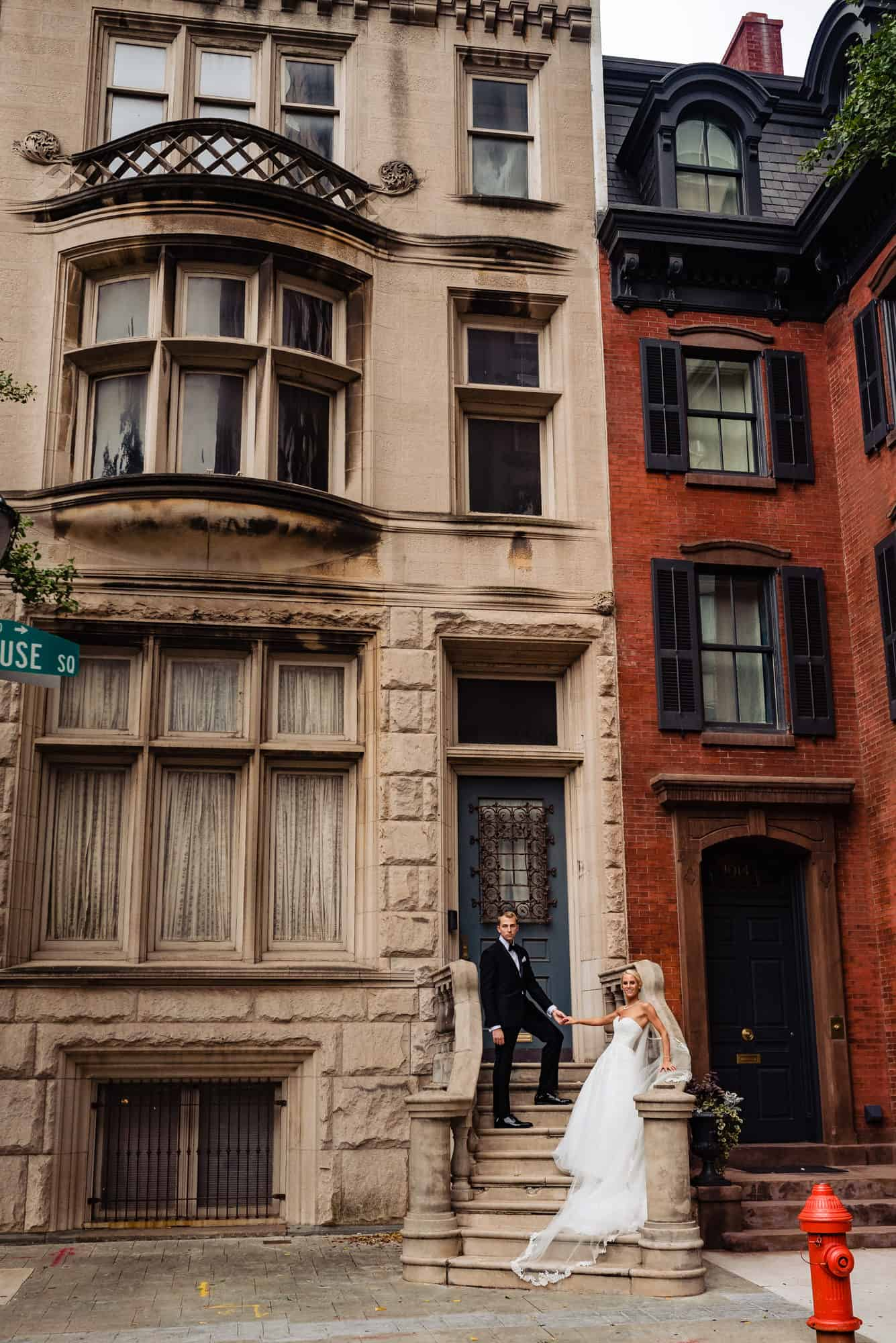 Ritz Carlton Philadelphia Wedding|bride and groom holding hands on city rowhome steps
