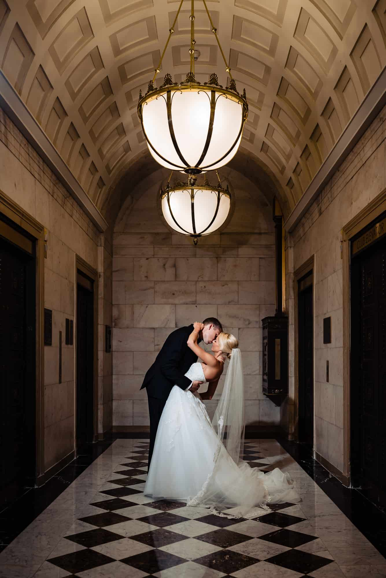 Ritz Carlton Philadelphia Wedding|romantic photo of bride and groom in hotel walkway