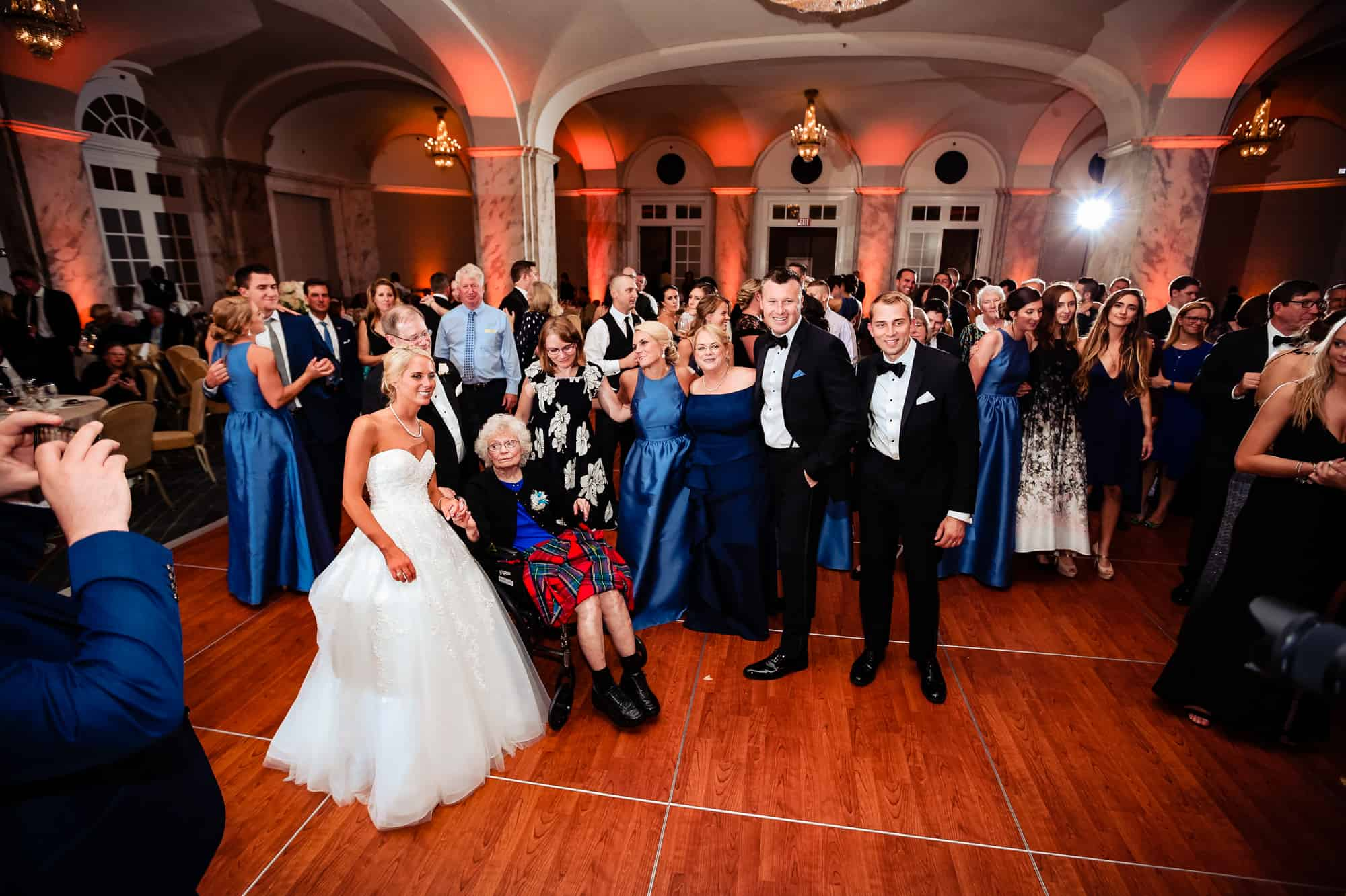 Ritz Carlton Philadelphia Wedding|bride and groom with family and friends during wedding reception