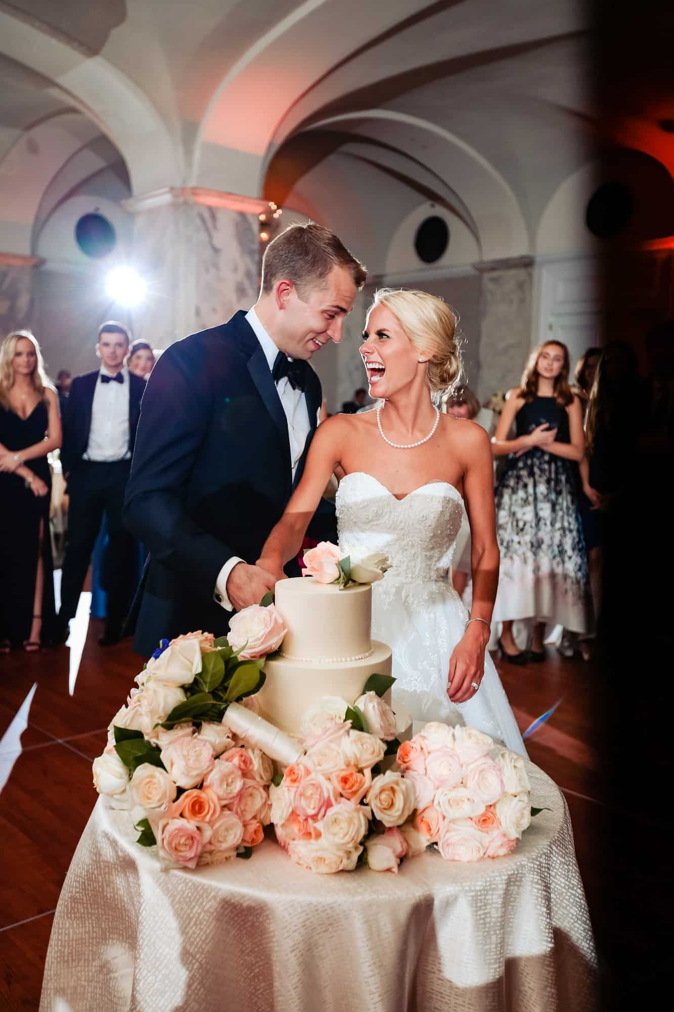 Ritz Carlton Philadelphia Wedding|bride and groom laughing while cutting wedding cake