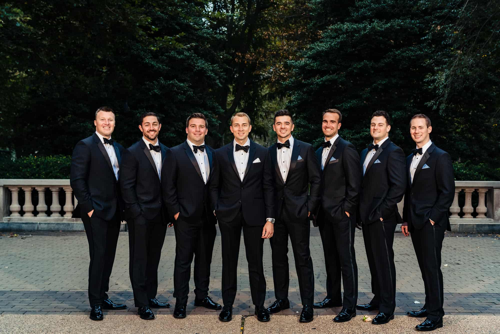 groomsman group photo in city park