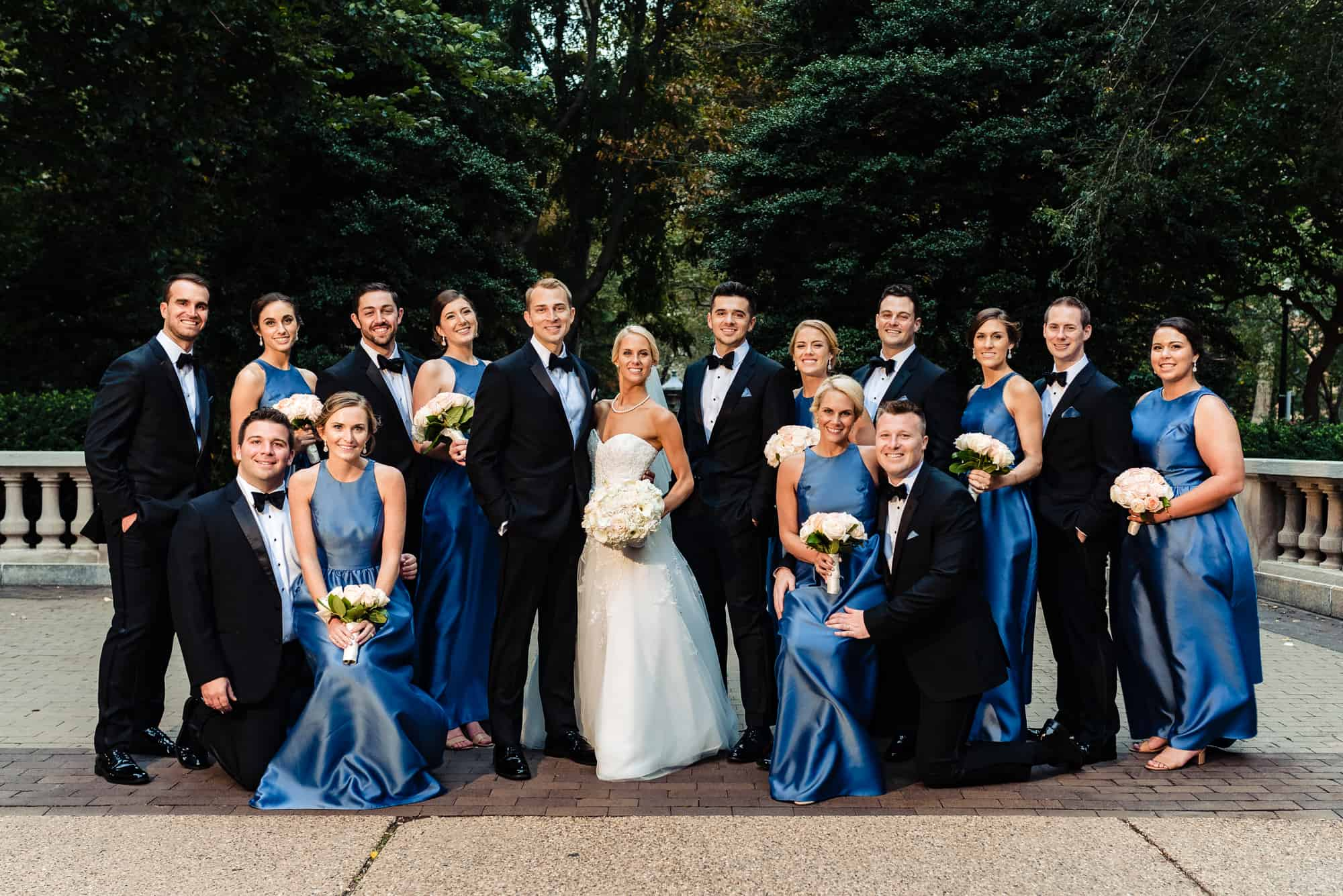 Bridal party group photo in city park