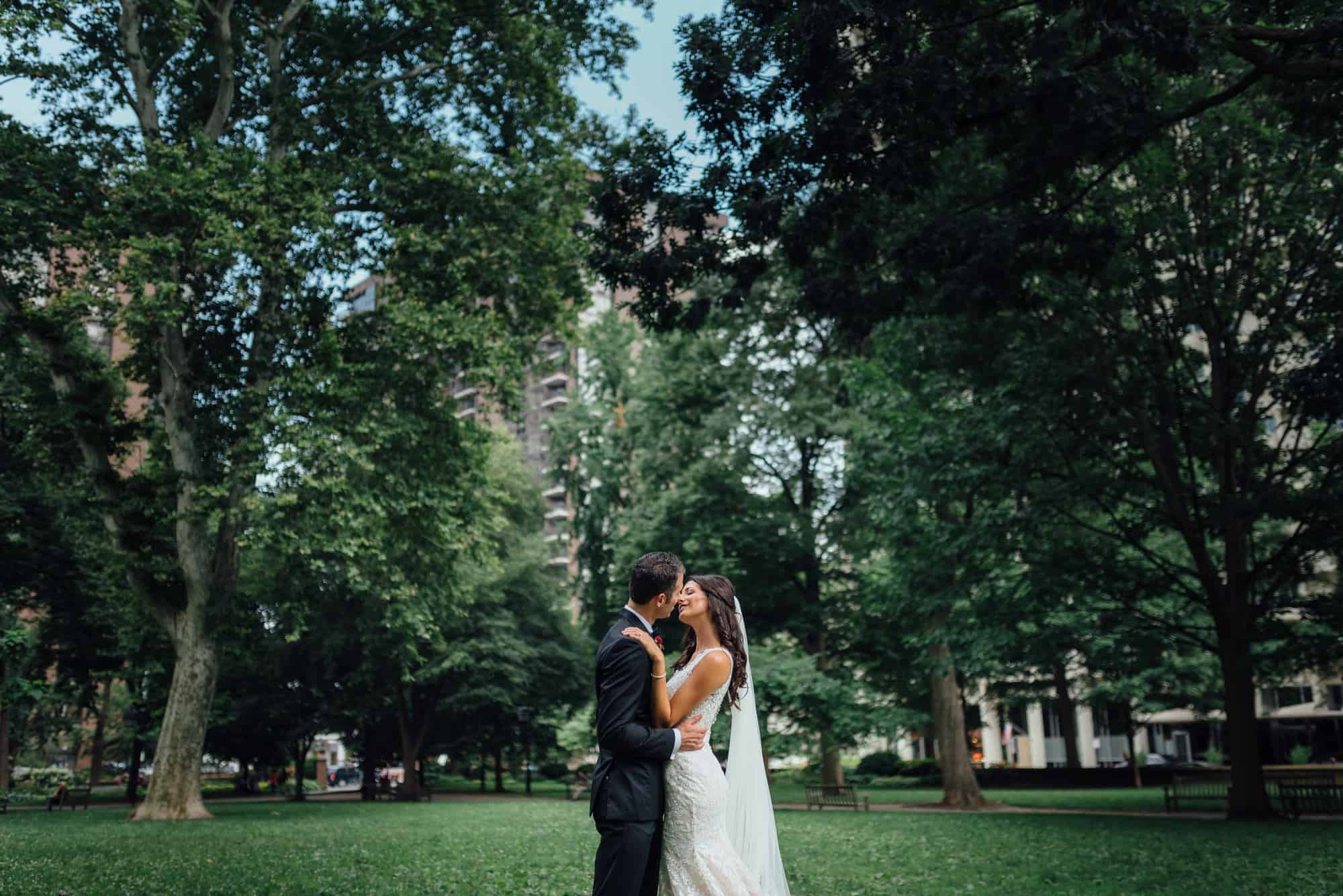 Bride and groom kiss in Washington Square Park