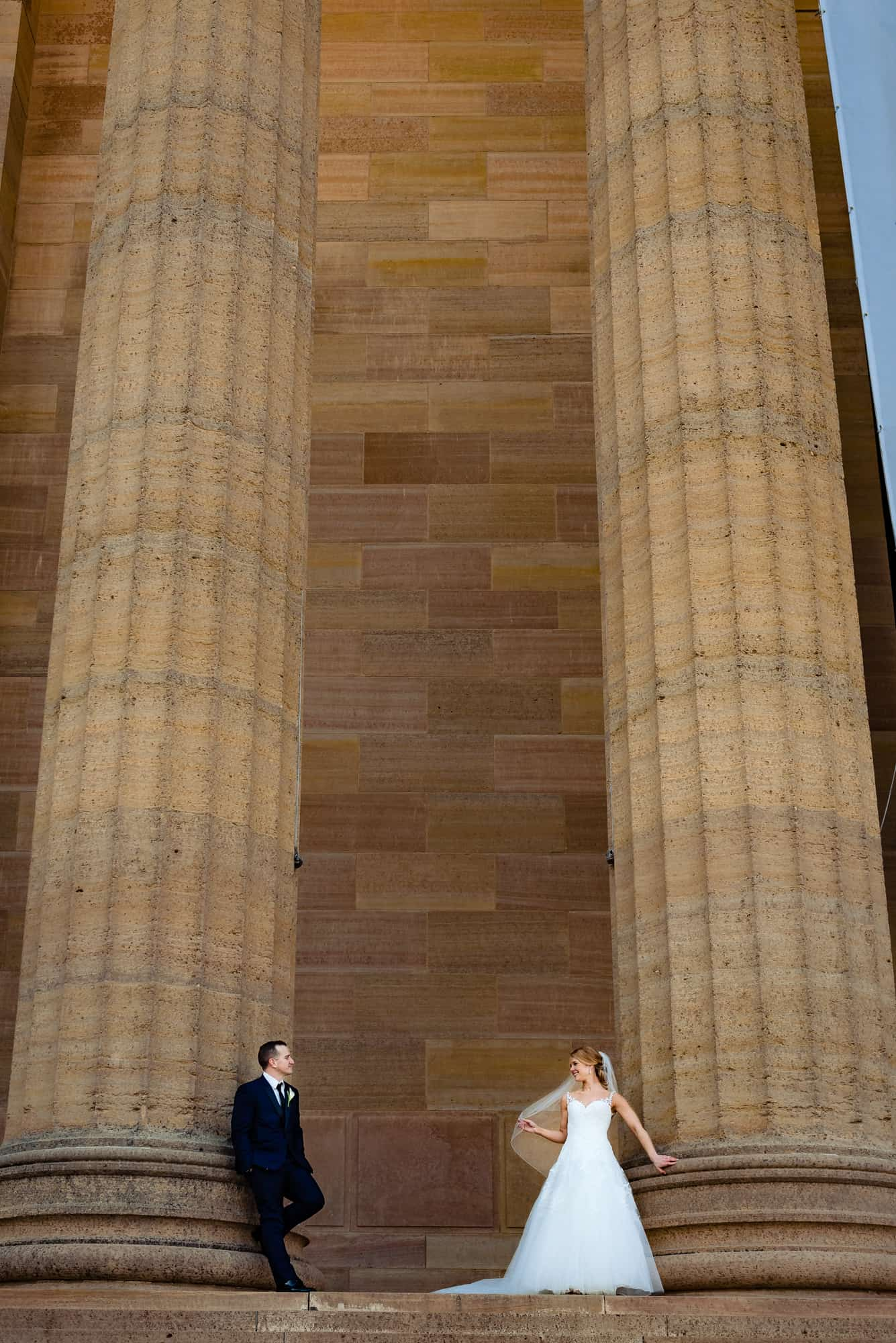 Bride and groom posing on the steps of the Philadelphia Museum of Art