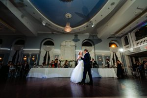 Wide shot of bride and groom dancing at the Arts Ballroom