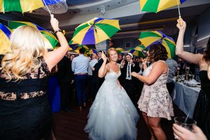Bride dancing with umbrella at the Arts Ballroom