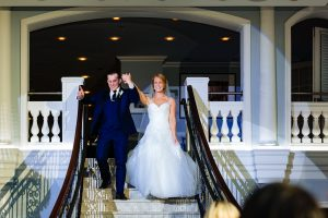 Bride and groom walking down stairs at the Arts Ballroom