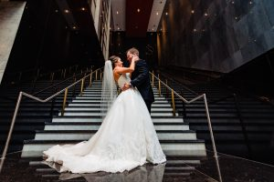 bride and groom embrace at the Loews Hotel in Philadelphia