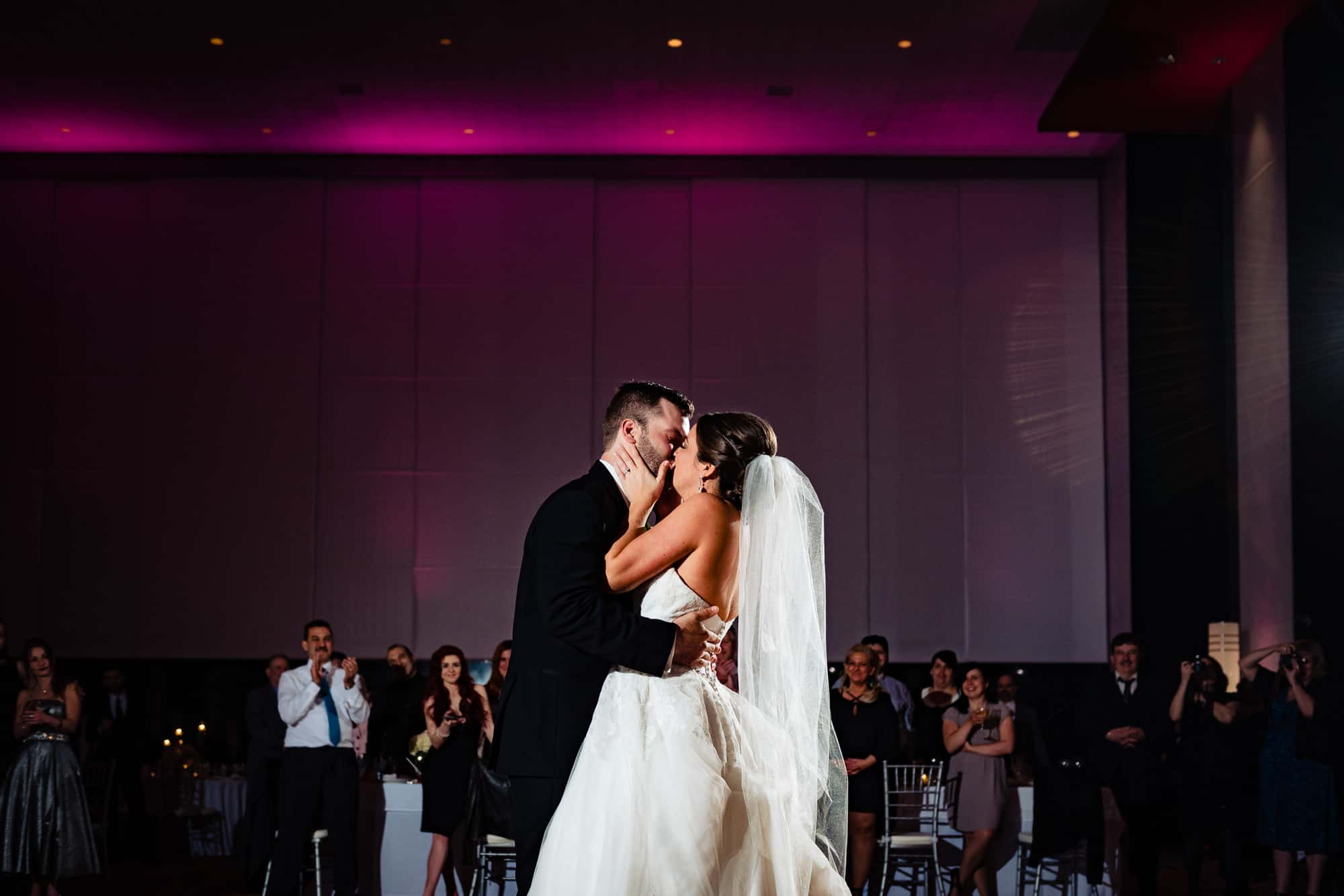 Bride kissing groom at the Loews Hotel in Philadelphia