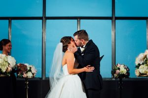 bride and groom first kiss at the Loews Hotel in Philadelphia