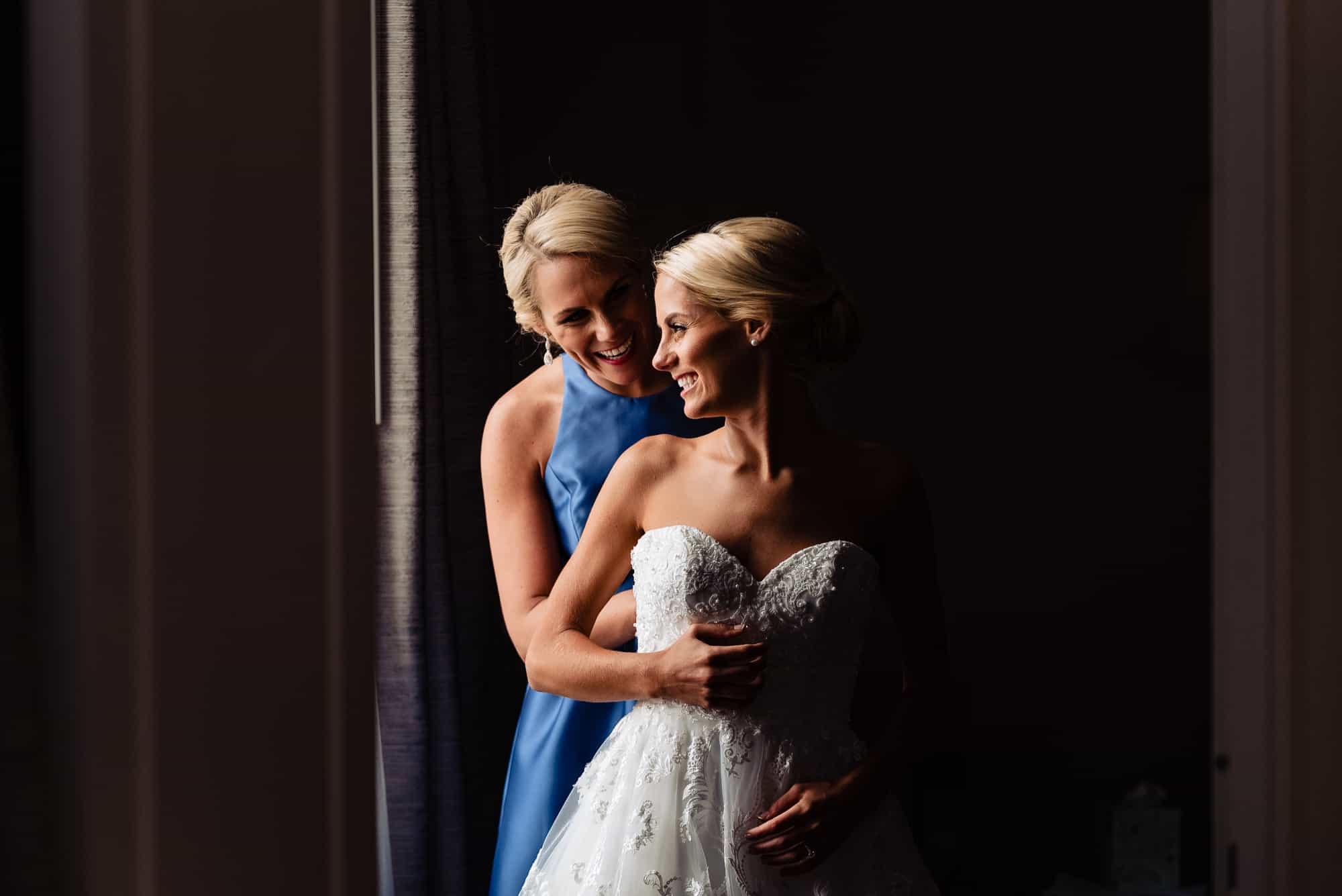 Bride and maid of honor laughing at the Ritz Carlton Philadelphia