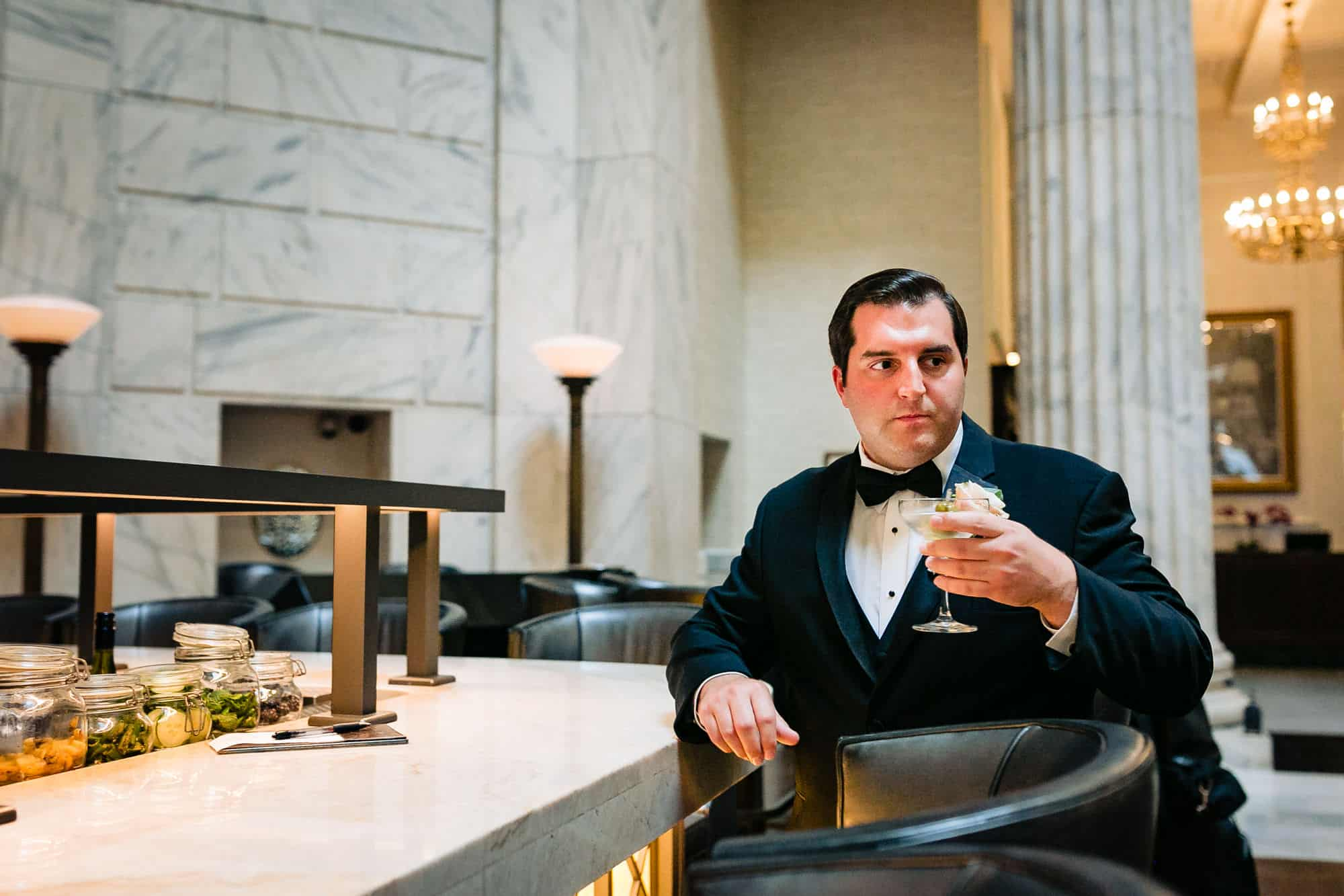 Groom drinking a martini at the Ritz Carlton Philadelphia