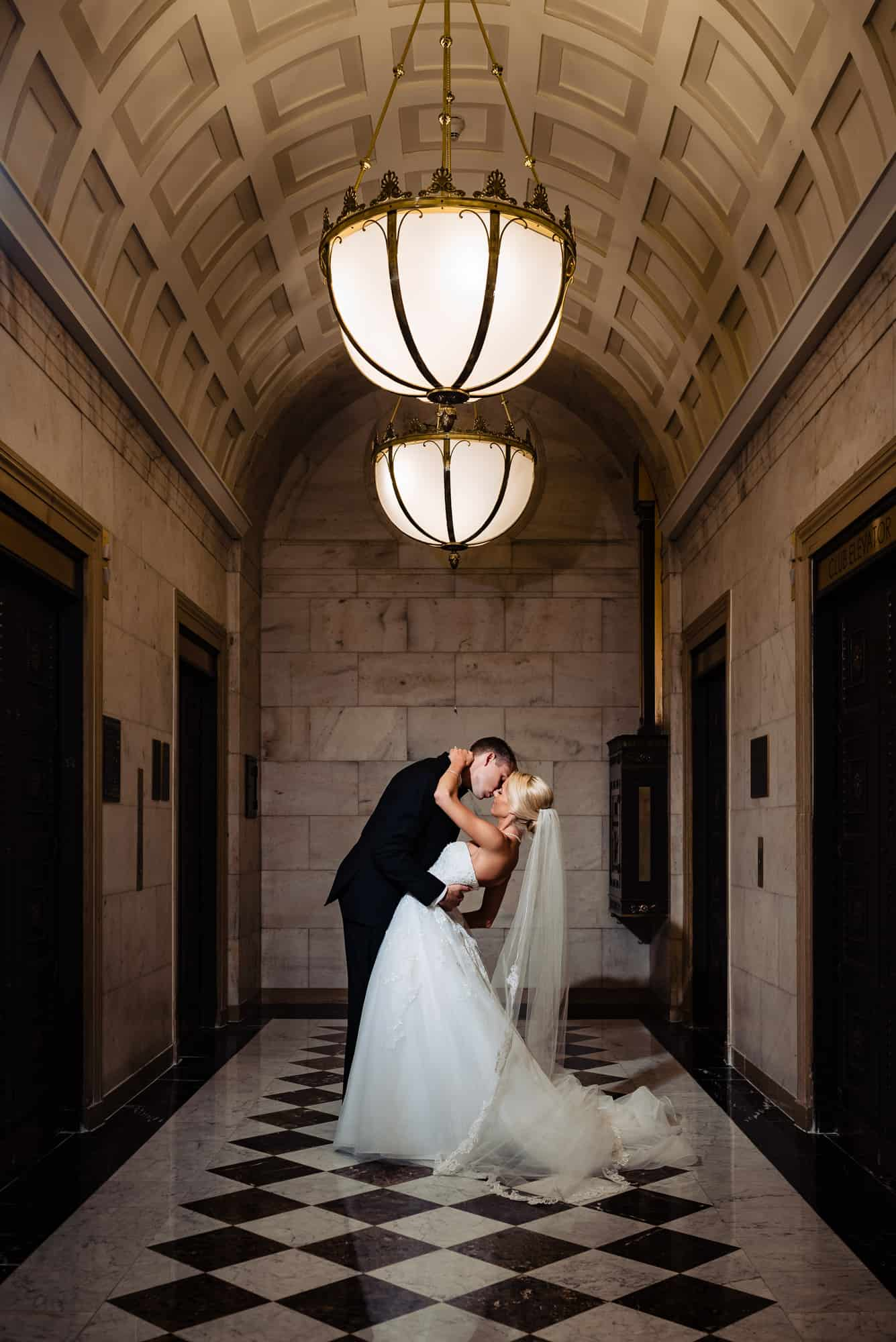 Bride and groom in epic wedding photo embracing at the Ritz Carlton Philadelphia