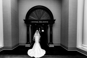 Bride and her father waiting to enter the ceremony Crystal Tea Room in Philadelphia
