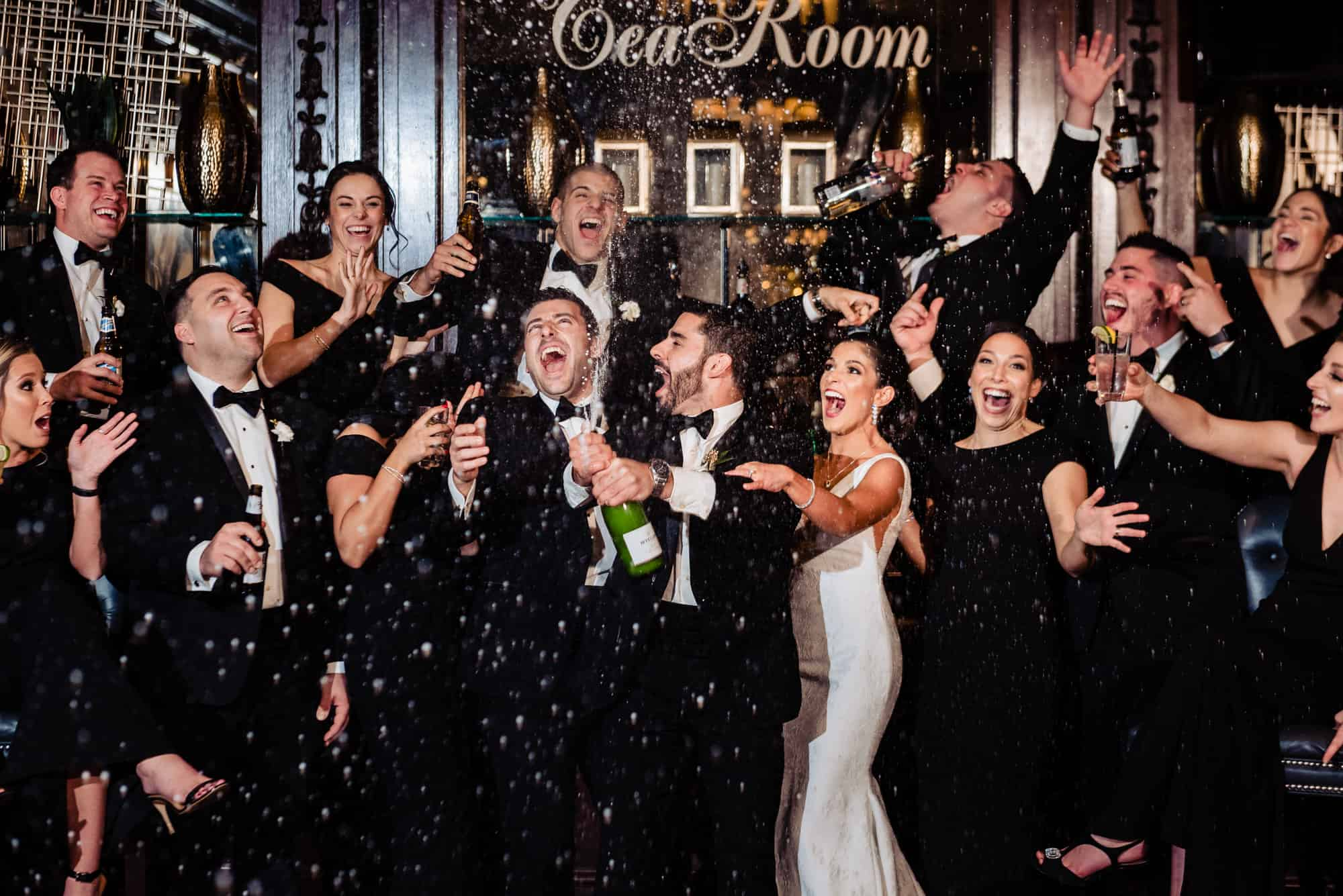 bridal party popping champagne at the Crystal Tea Room in Philadelphia