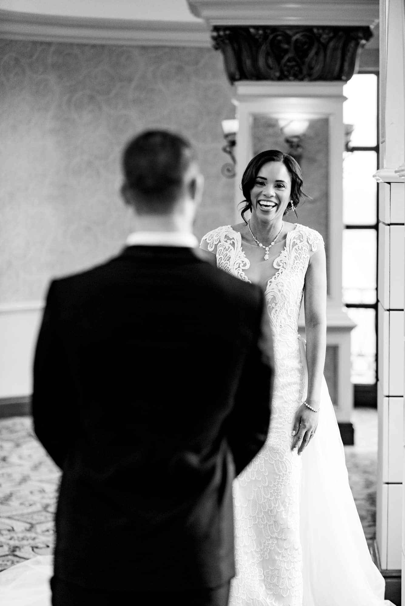 Bride and groom first look at their Claridge Hotel Wedding