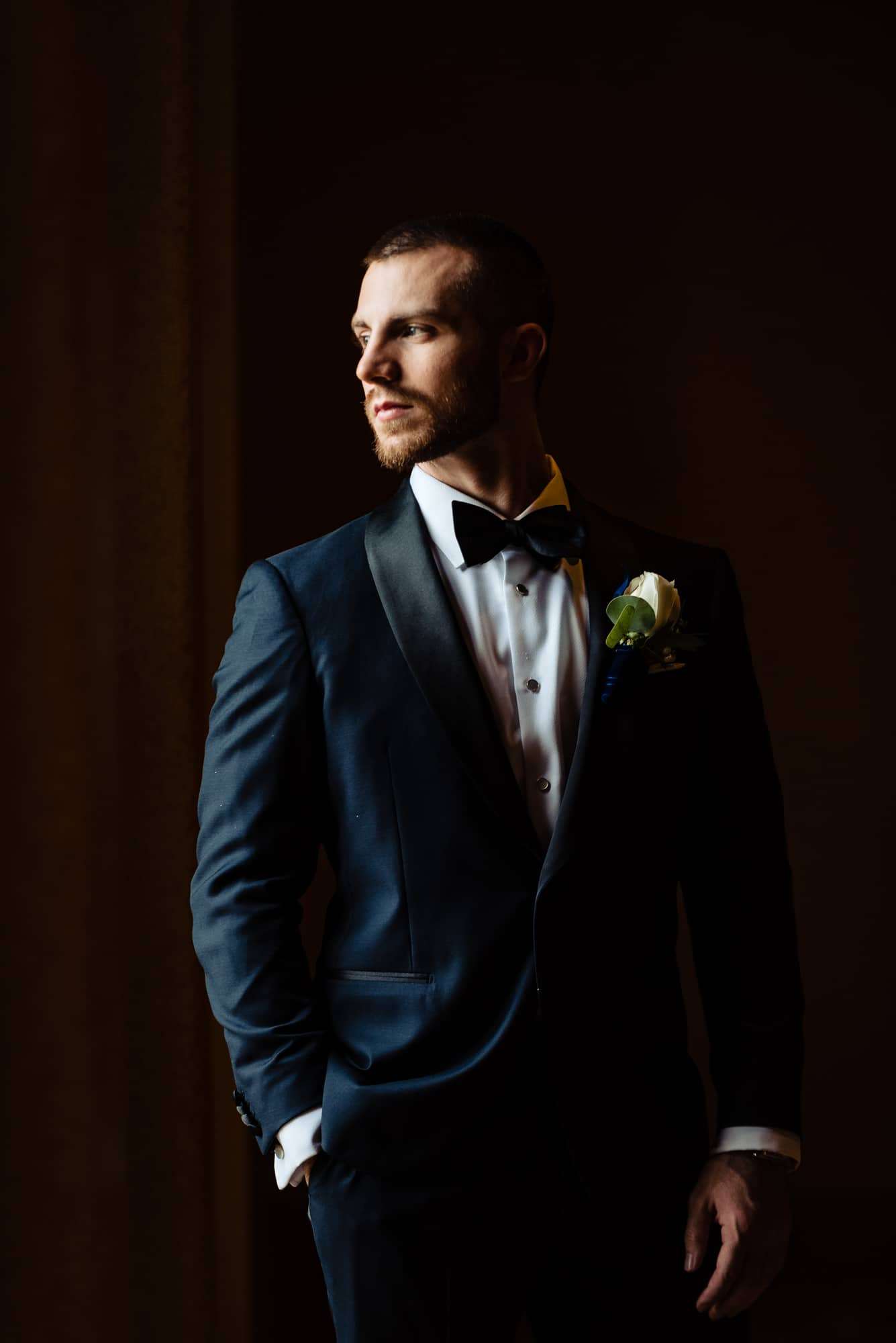 Groom posing in beautiful window light