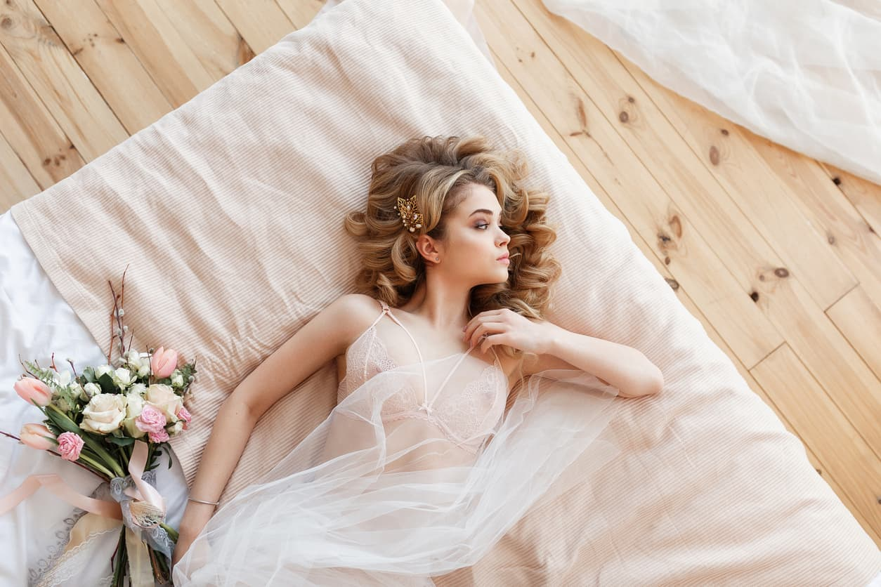 boudoir photo session with blushing bride