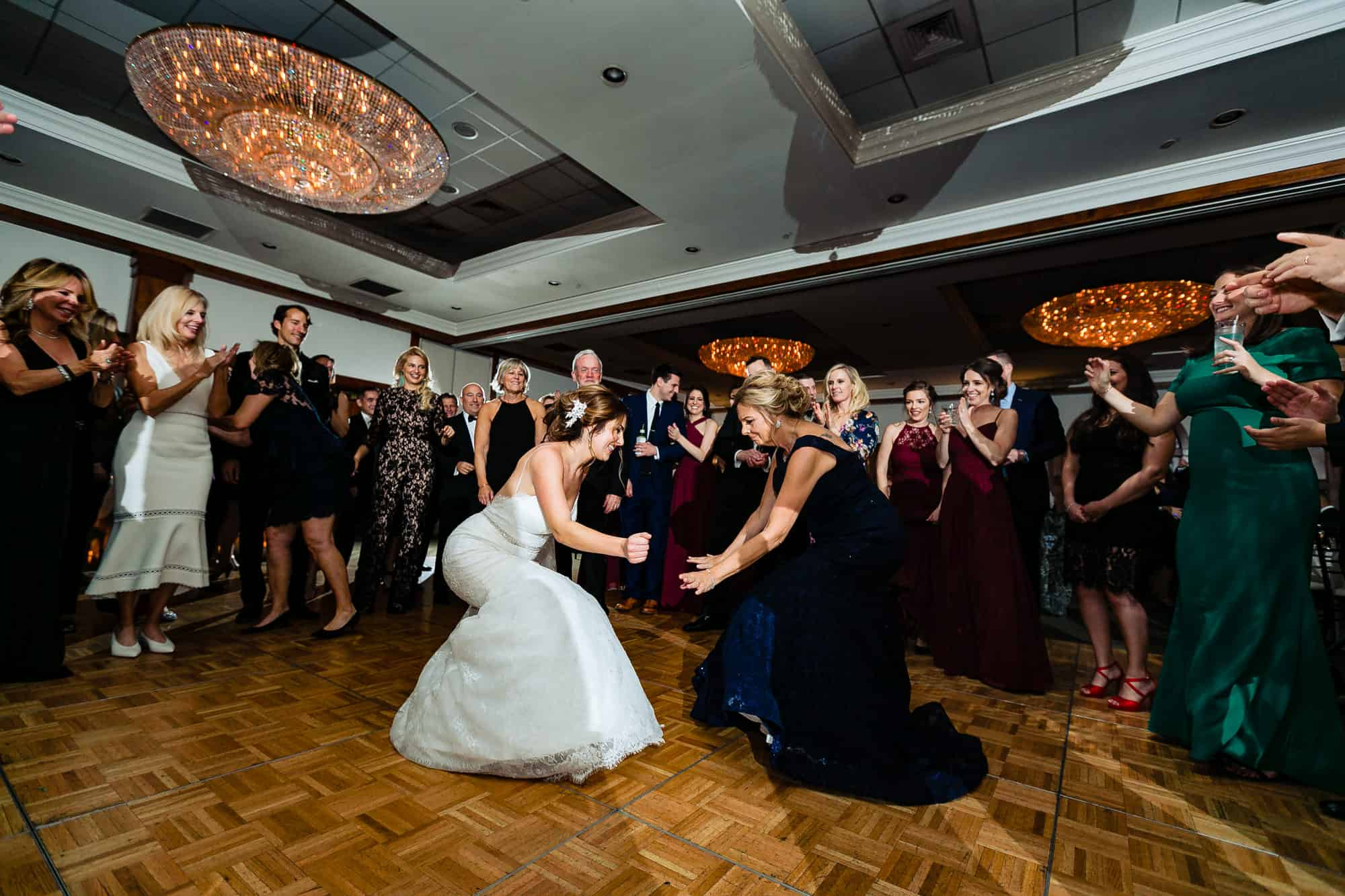 Bride and her mother dancing during wedding reception