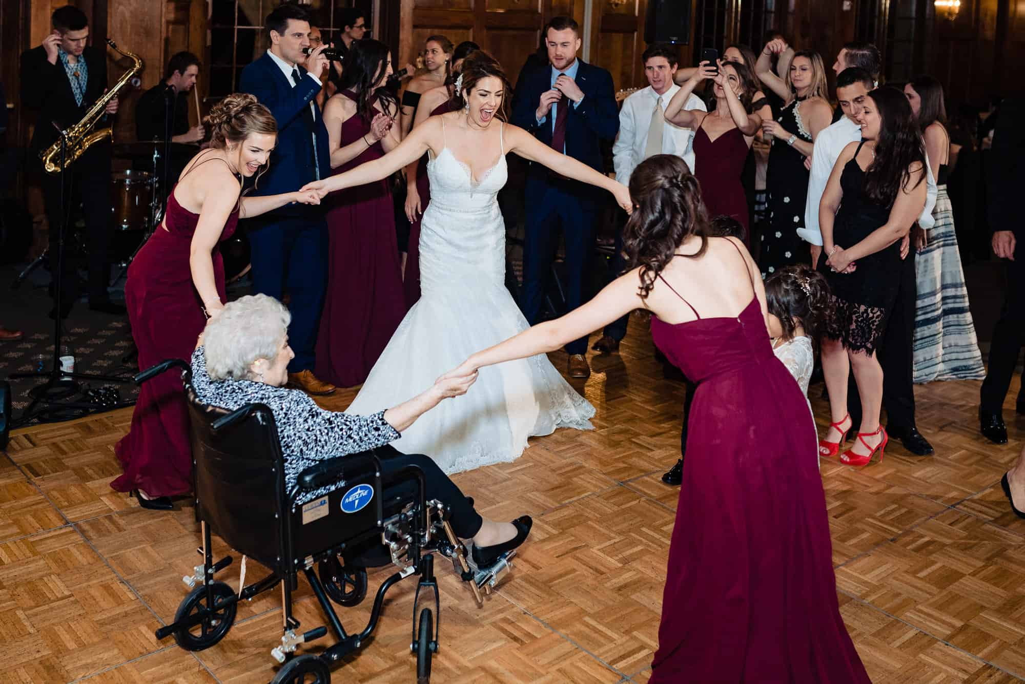Bride and her grandmother dancing with bridesmaids