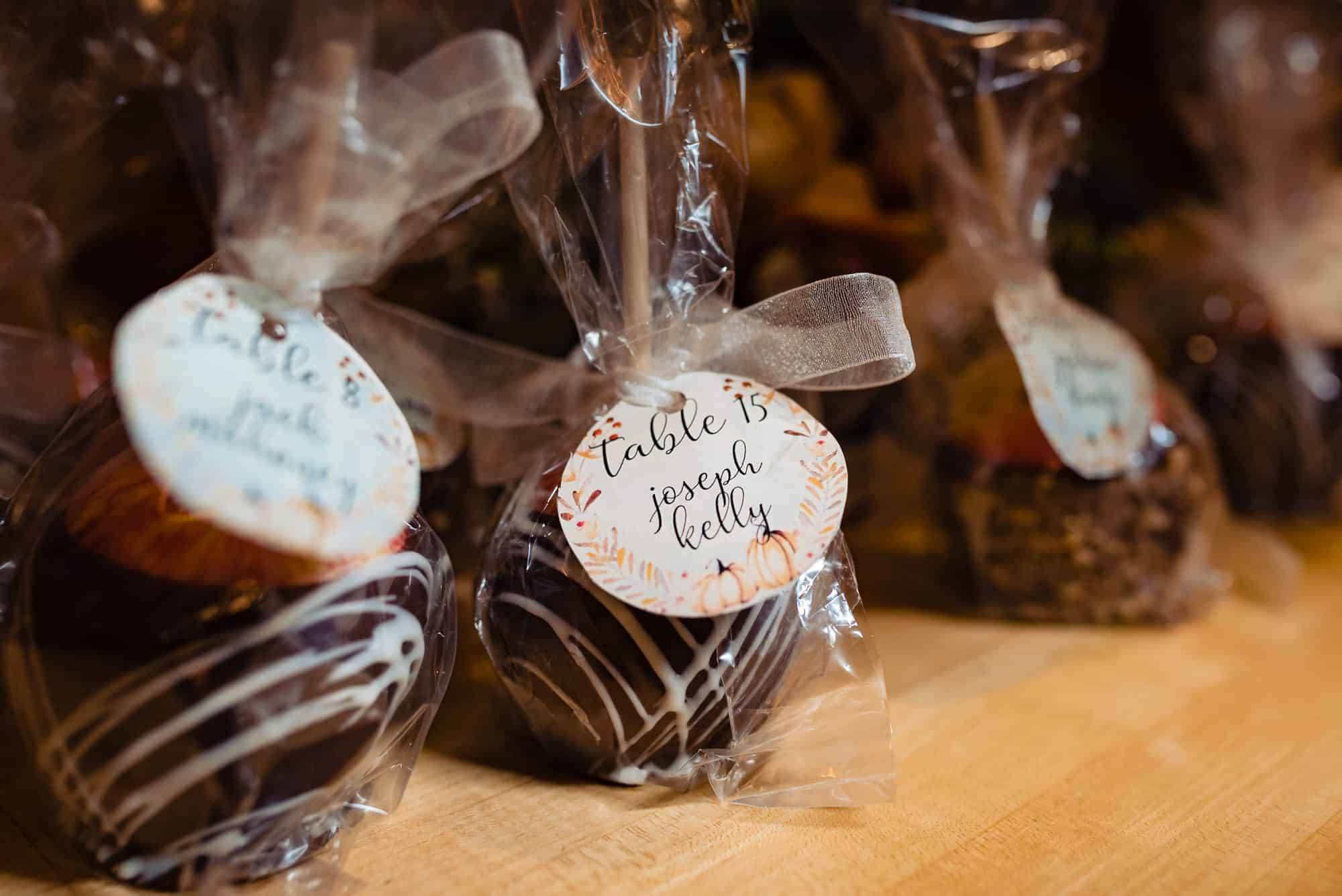 Caramel apple wedding favors with a bow wrapped around them