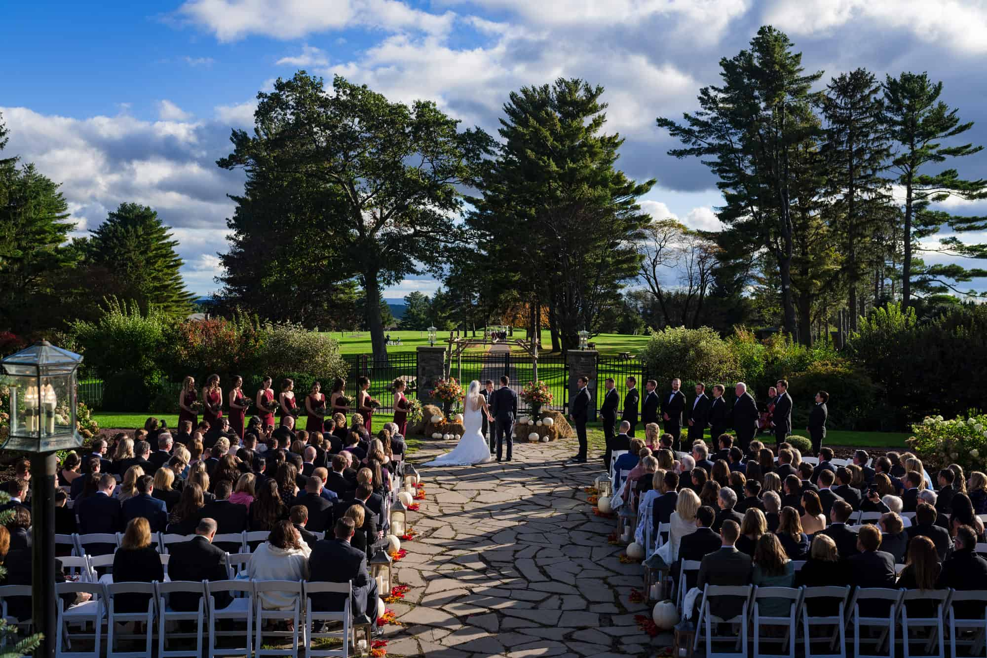 Bride and groom holding hands at outdoor wedding ceremony at Skytop Lodge PA