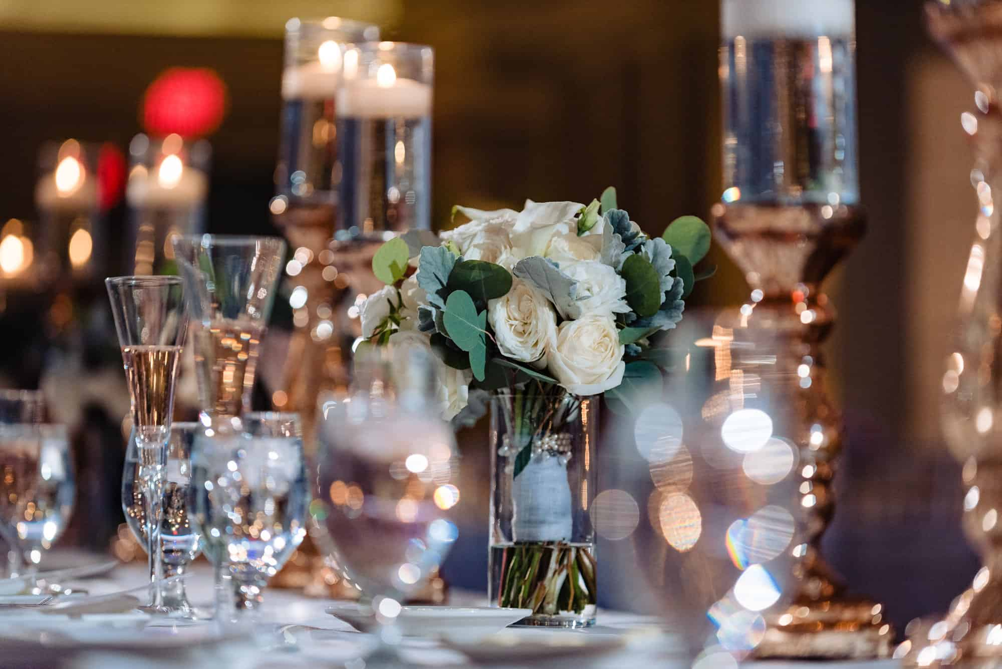 Image of brides white flower centerpiece from an Arts Ballroom Wedding in Philadelphia