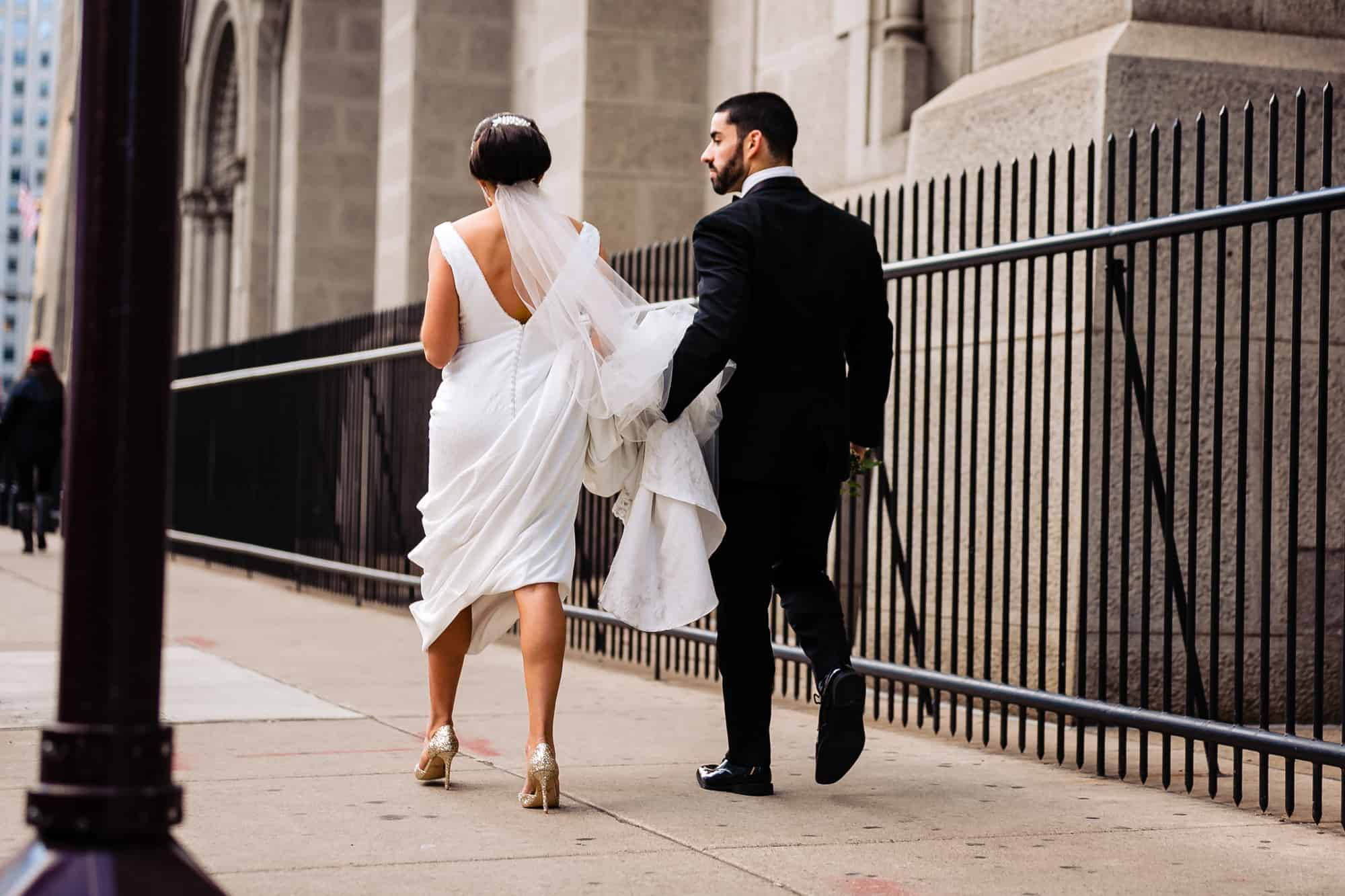 Bride and groom walking in city