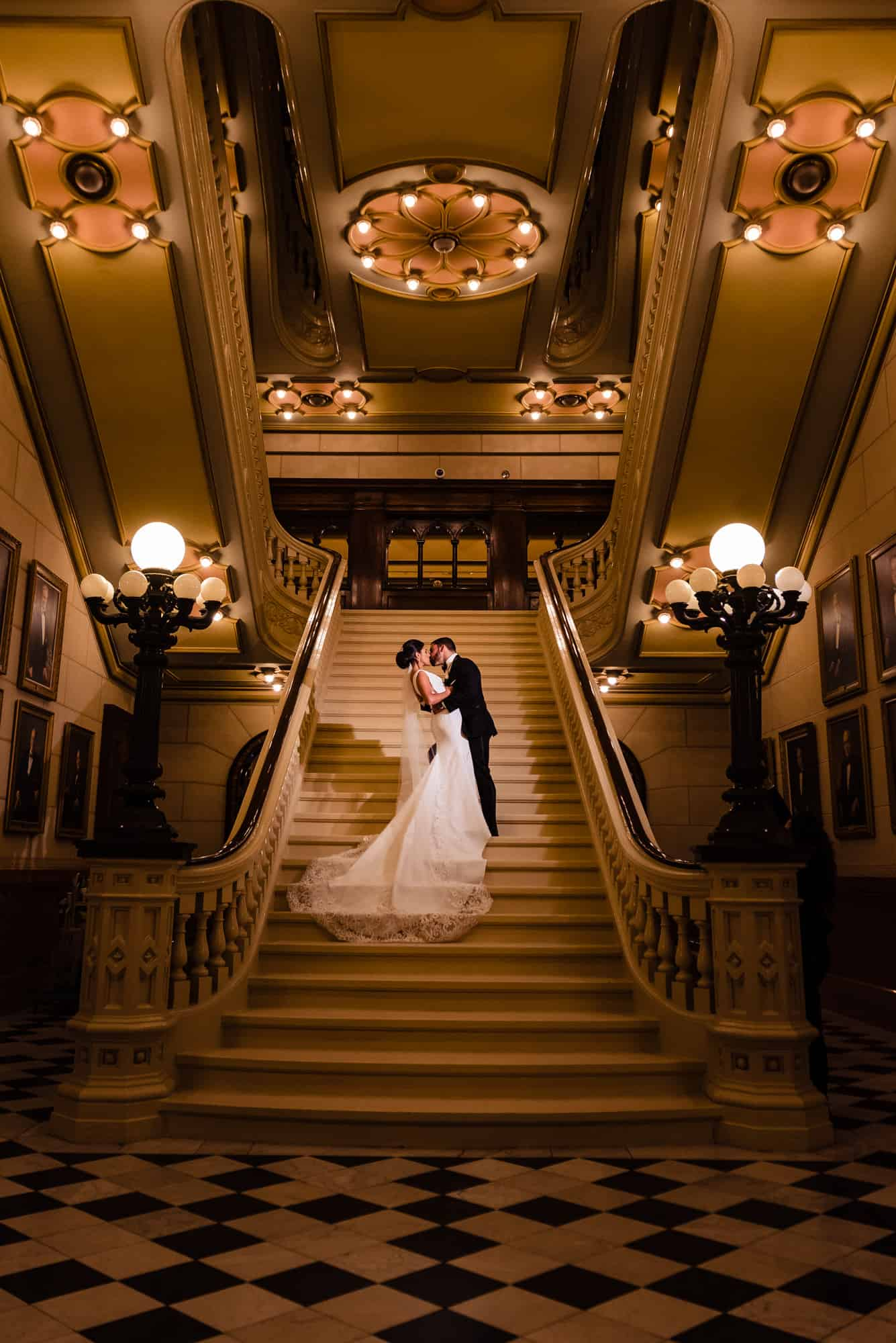 Bride and groom kiss on stairwell