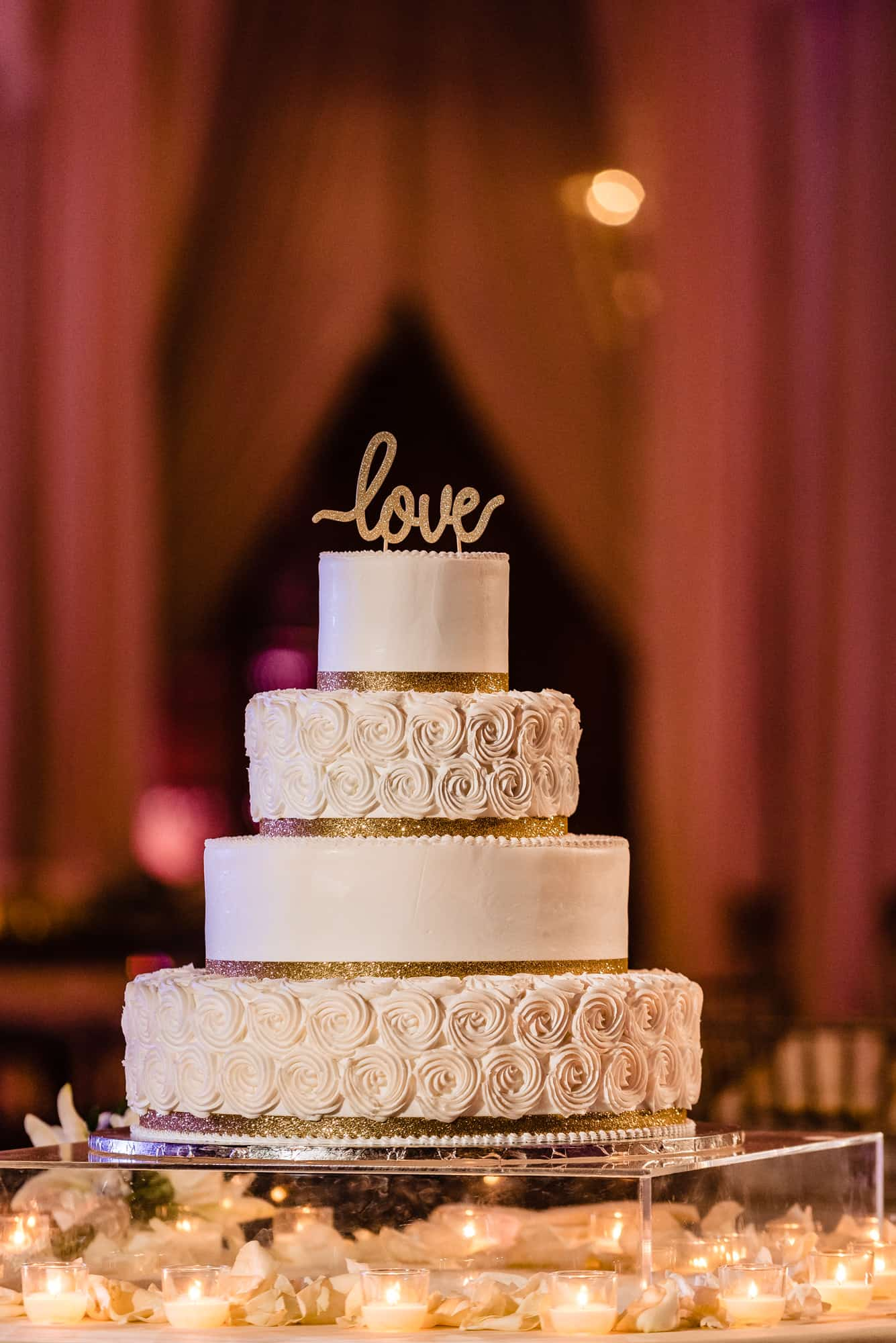Love topper on wedding cake