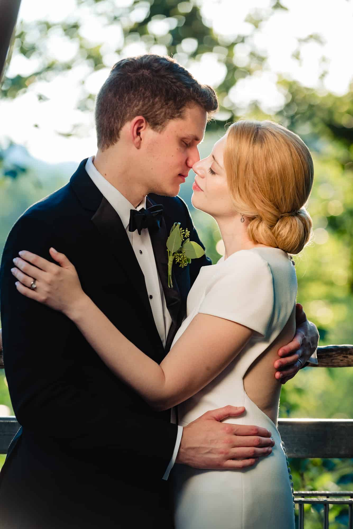 romantic image of bride and groom at their Morris Arboretum Wedding