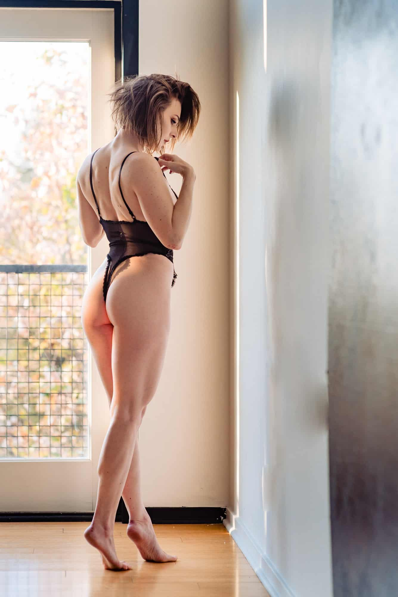 boudoir photo of woman in black lingerie