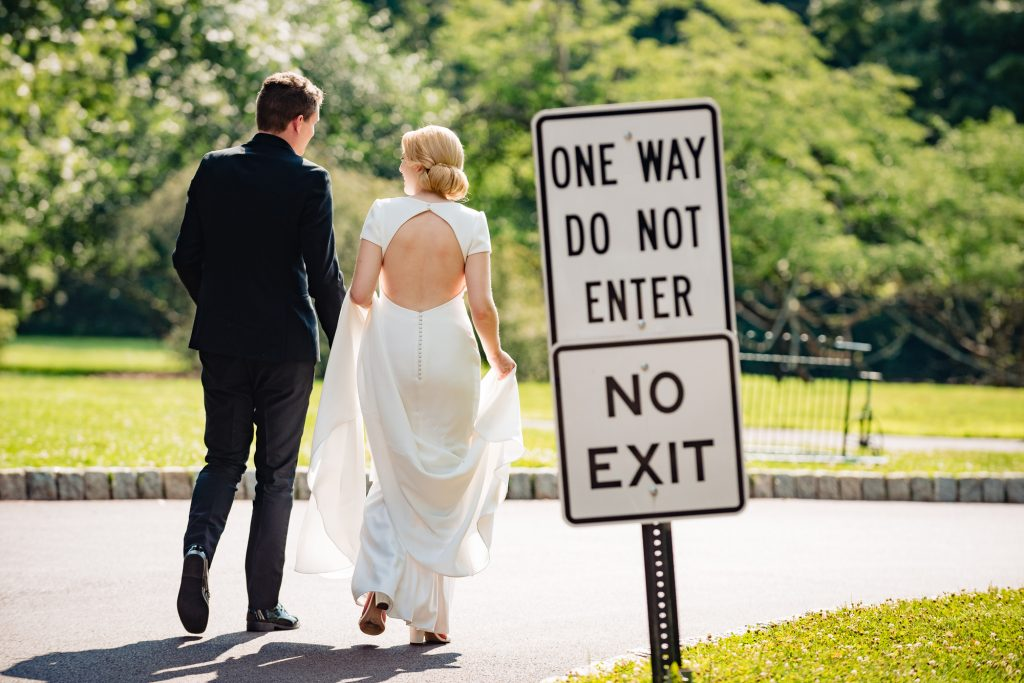 bride and groom walking by do not enter sign at the Morris Arboretum
