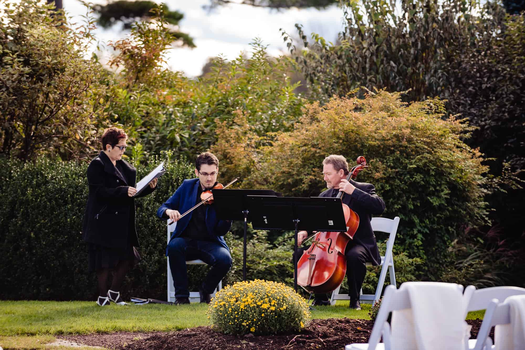 musicians at an outdoor wedding playing wedding reception music
