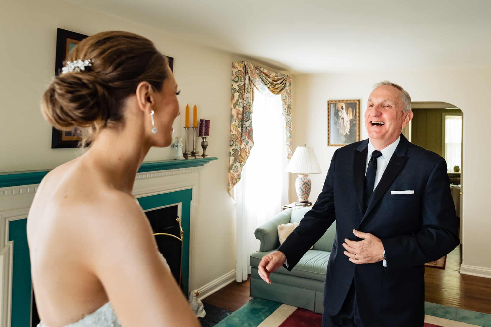 father of the bride smiling after seeing his daughter before her Hotel DuPont Wedding