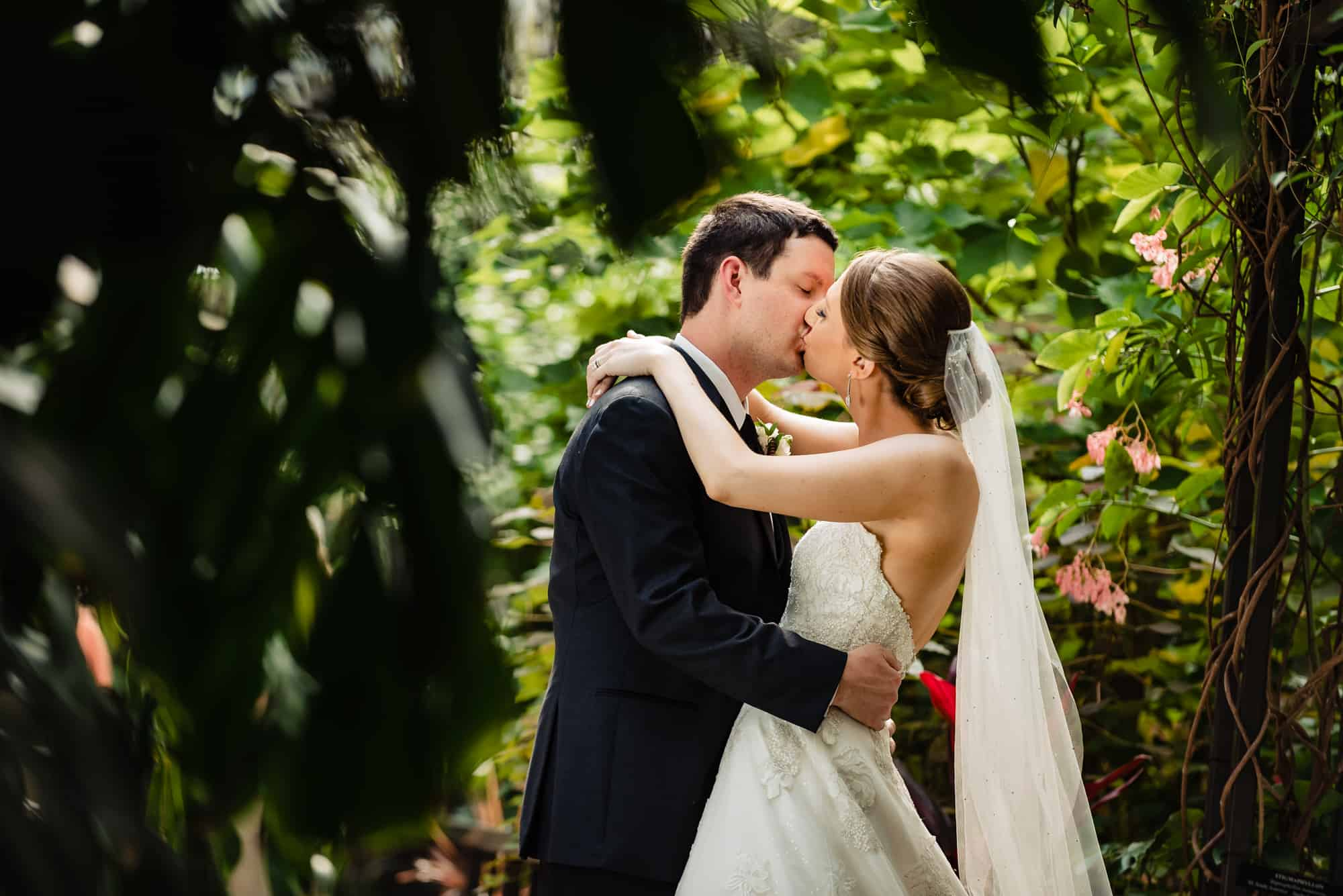 bride and groom kissing at Longwood Gardens