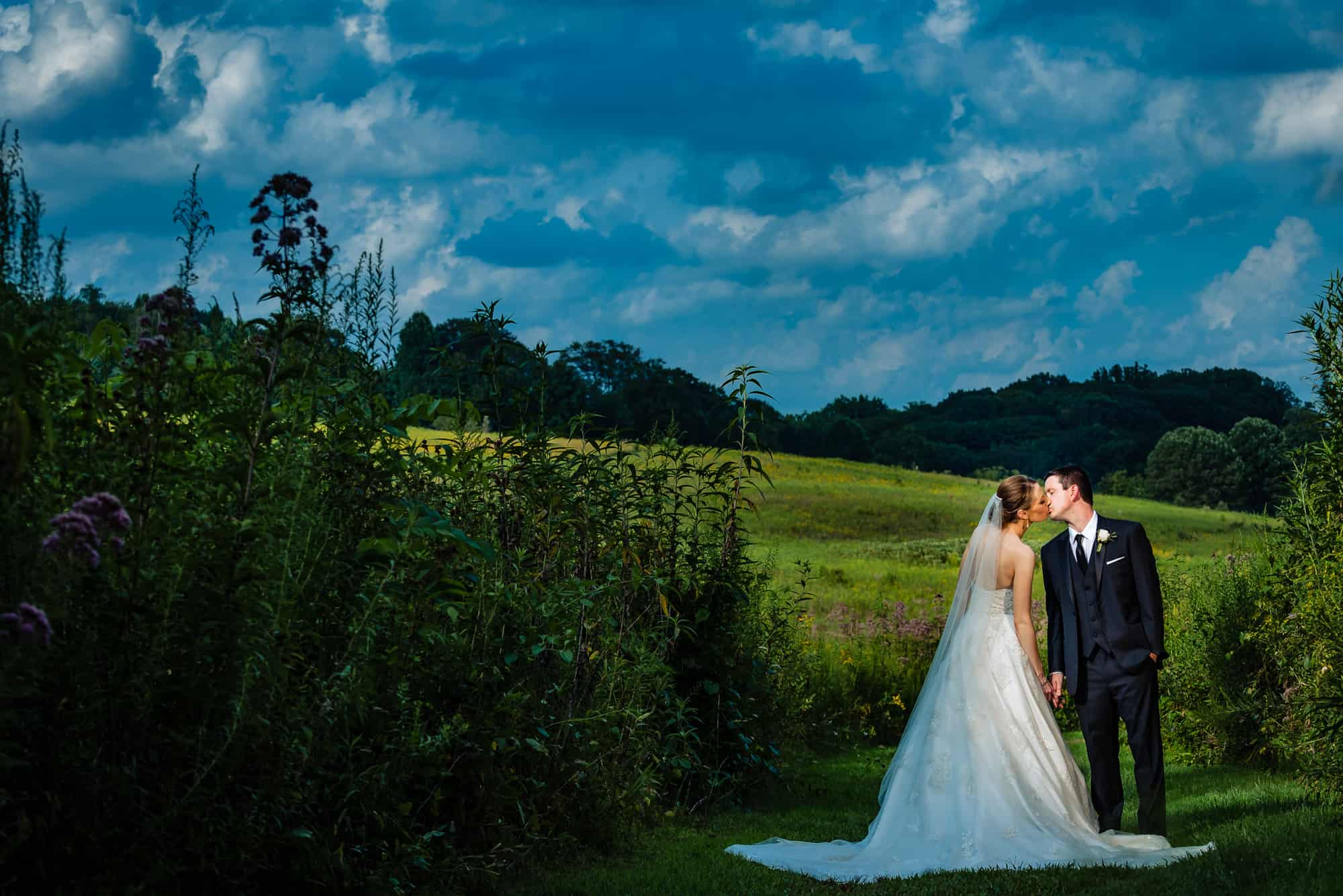 dramtic light on bride and groom in epic wedding photo