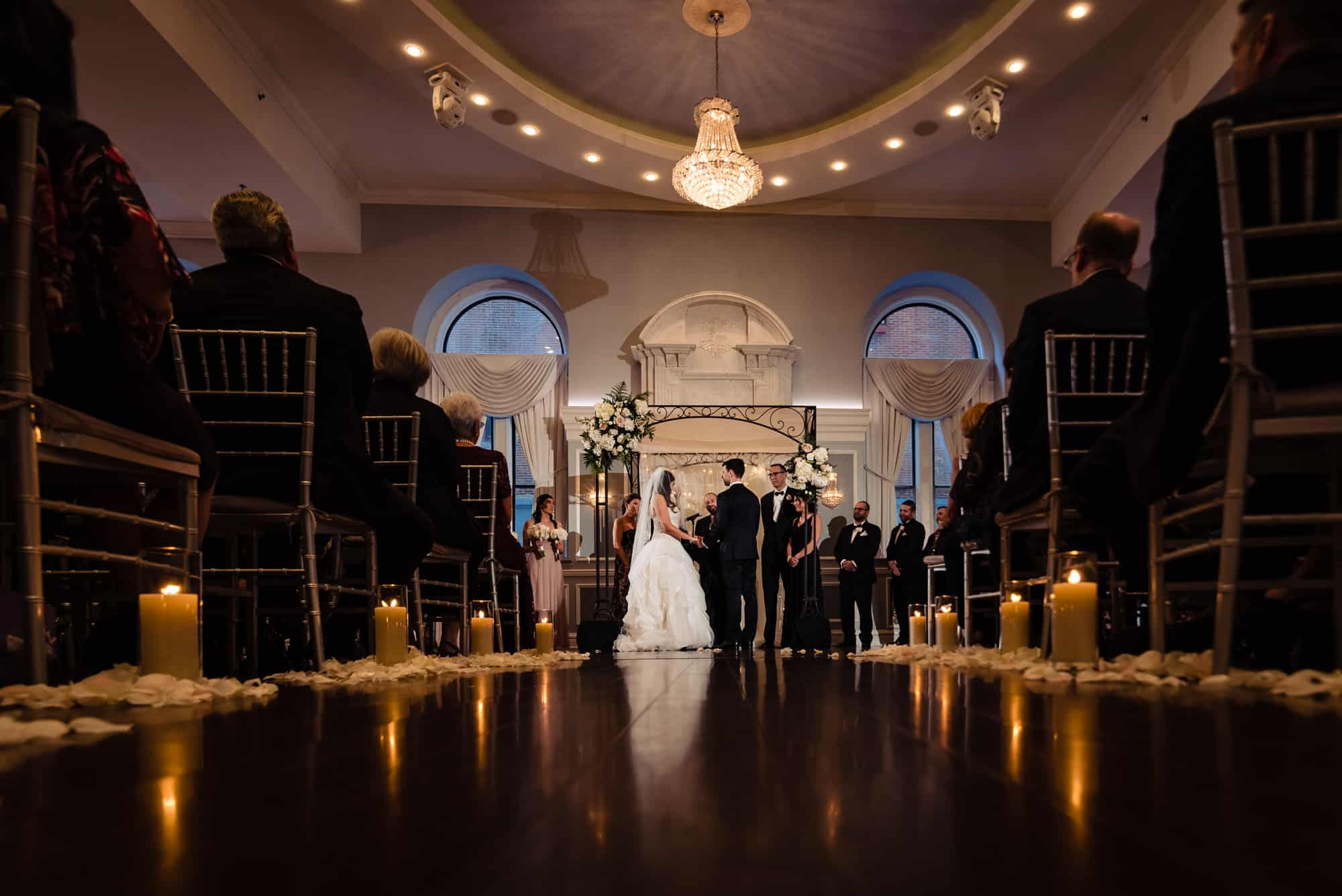wide shot from low perspective of bride and groom during their Arts Ballroom ceremony