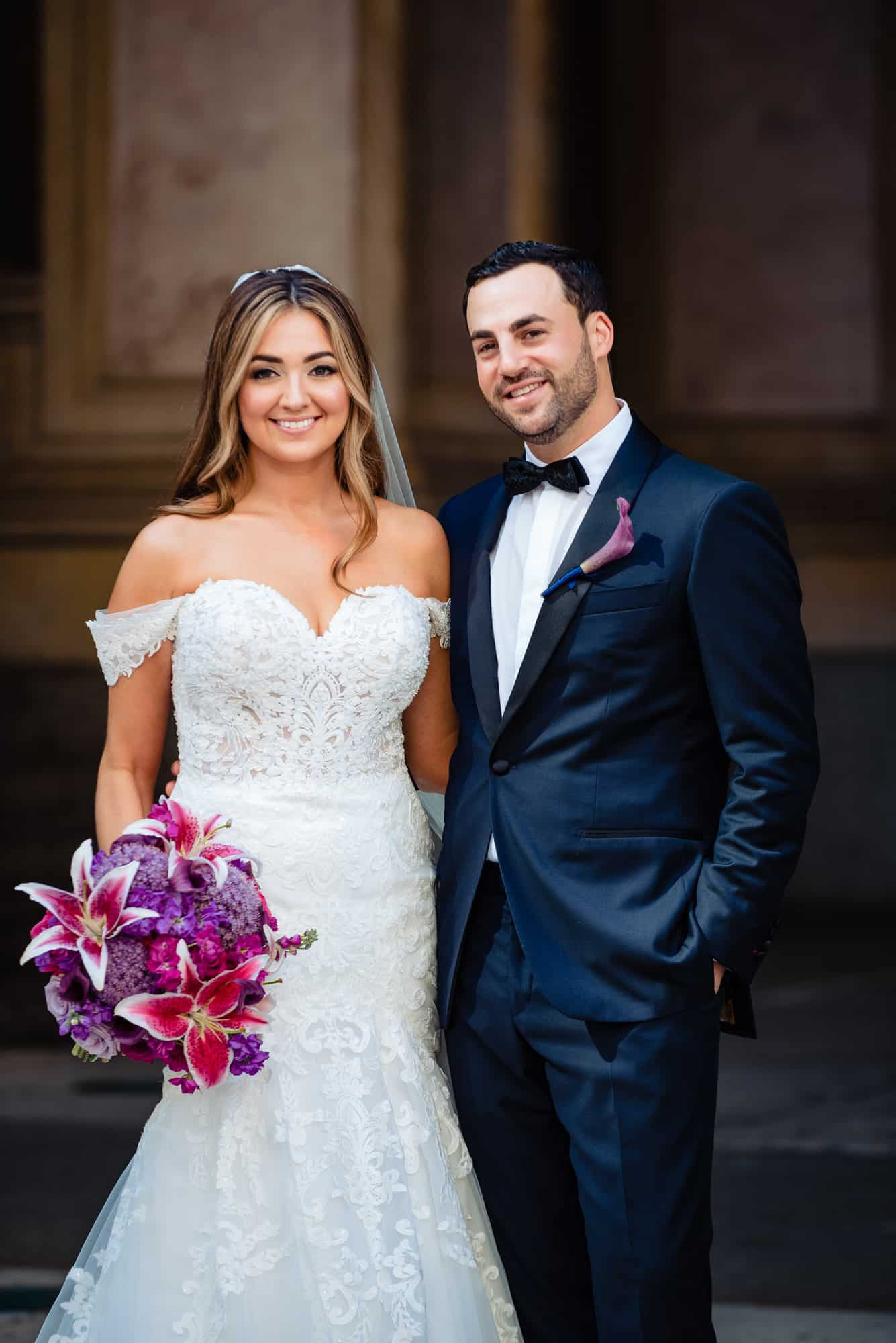 bride and groom posing for a photo during their Center City wedding