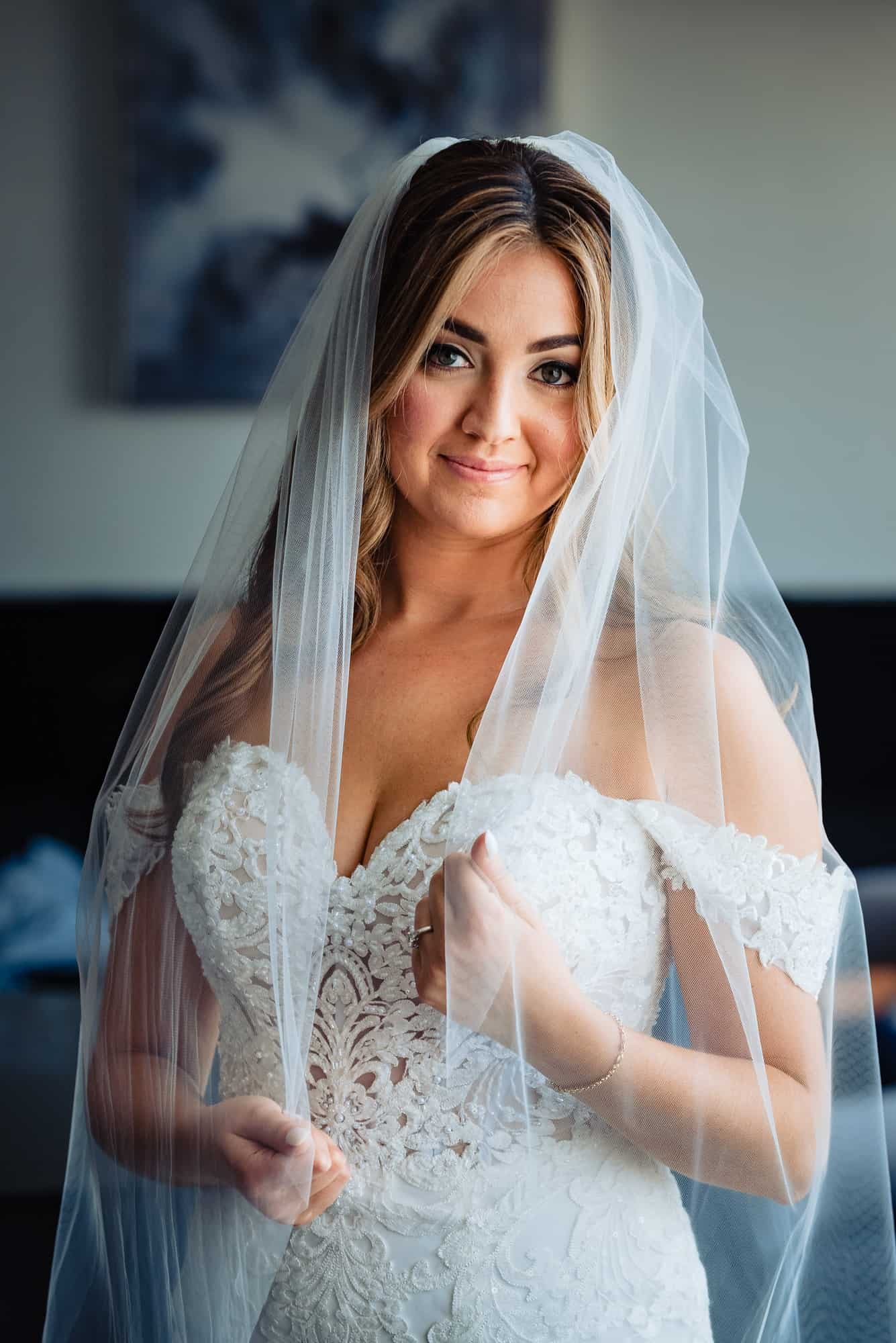 image of bride posing holding veil, hair and makeup by C.E.Facial Artistry