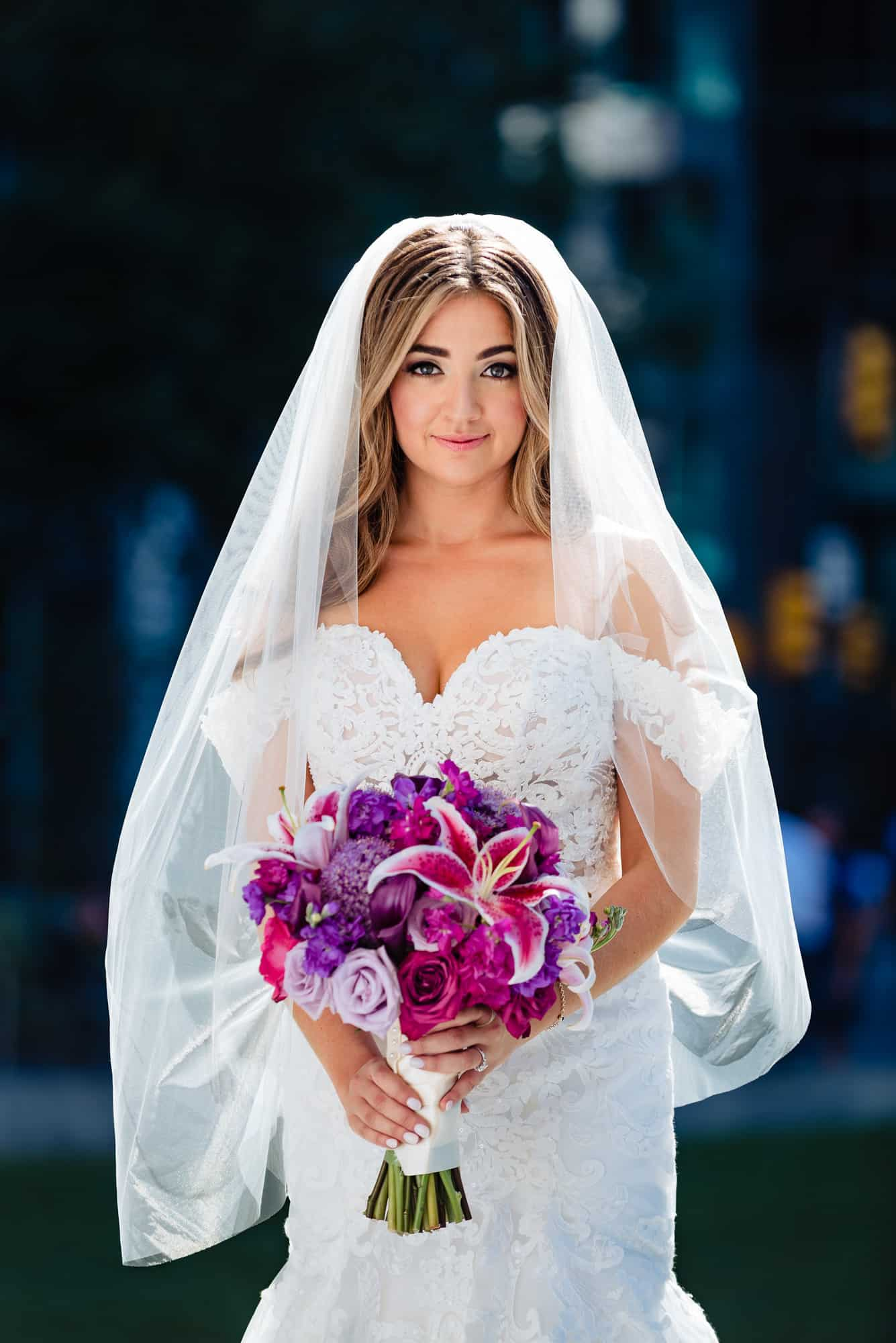 image of bride in a stella york dress before her Loews Philadelphia Wedding