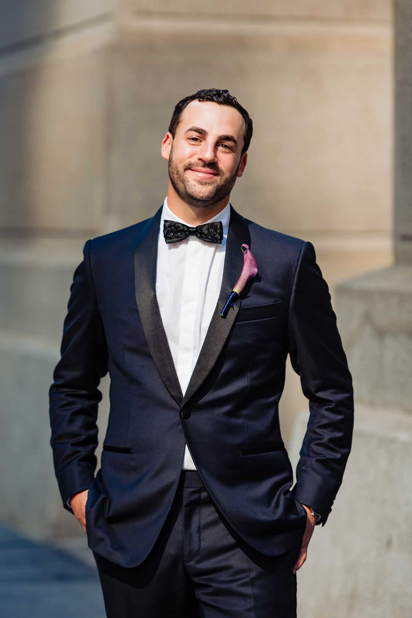 image of groom in a birmingham tailor suit before his Loews Philadelphia Wedding