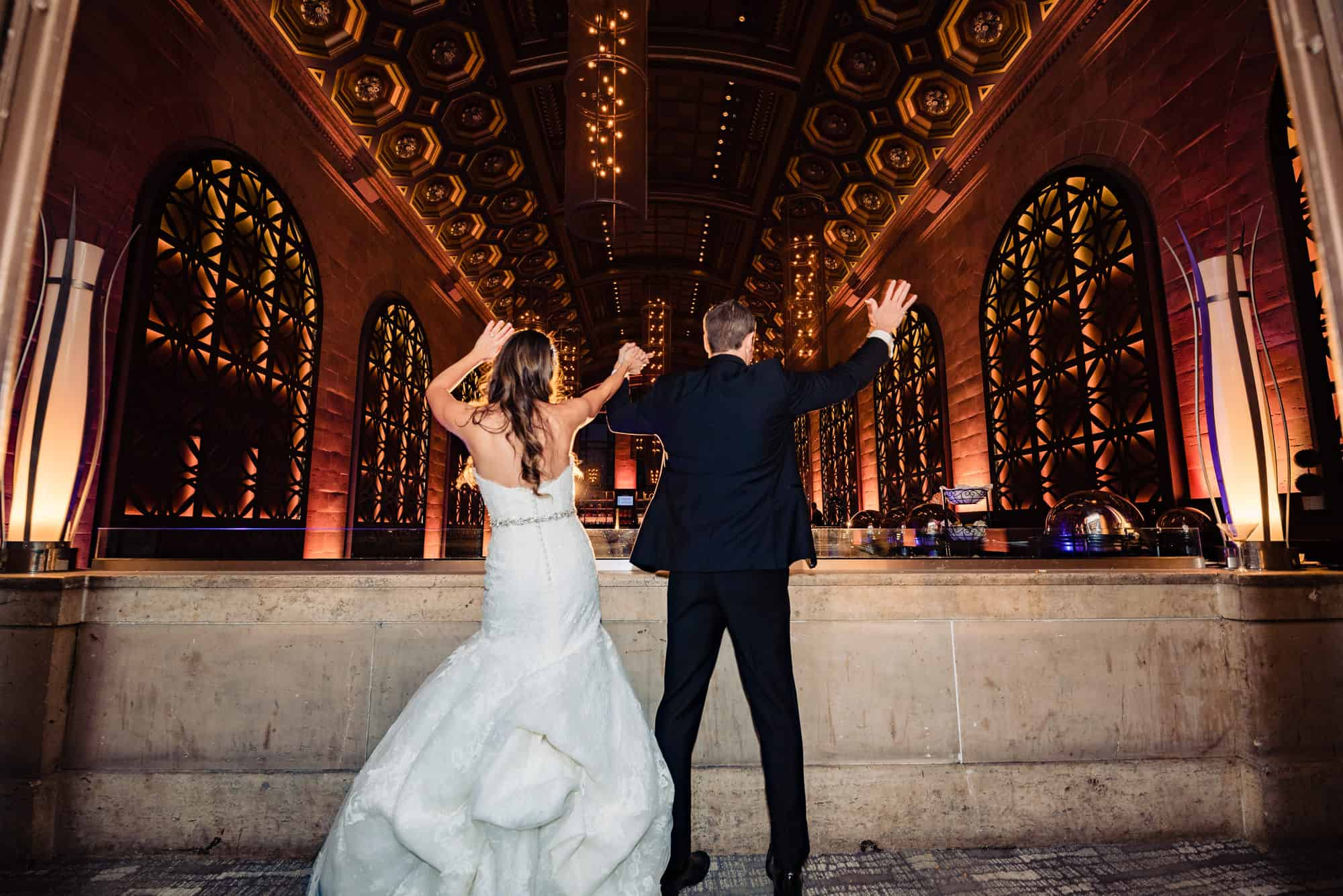 bride and groom celebrate at their Union Trust Ballroom wedding reception