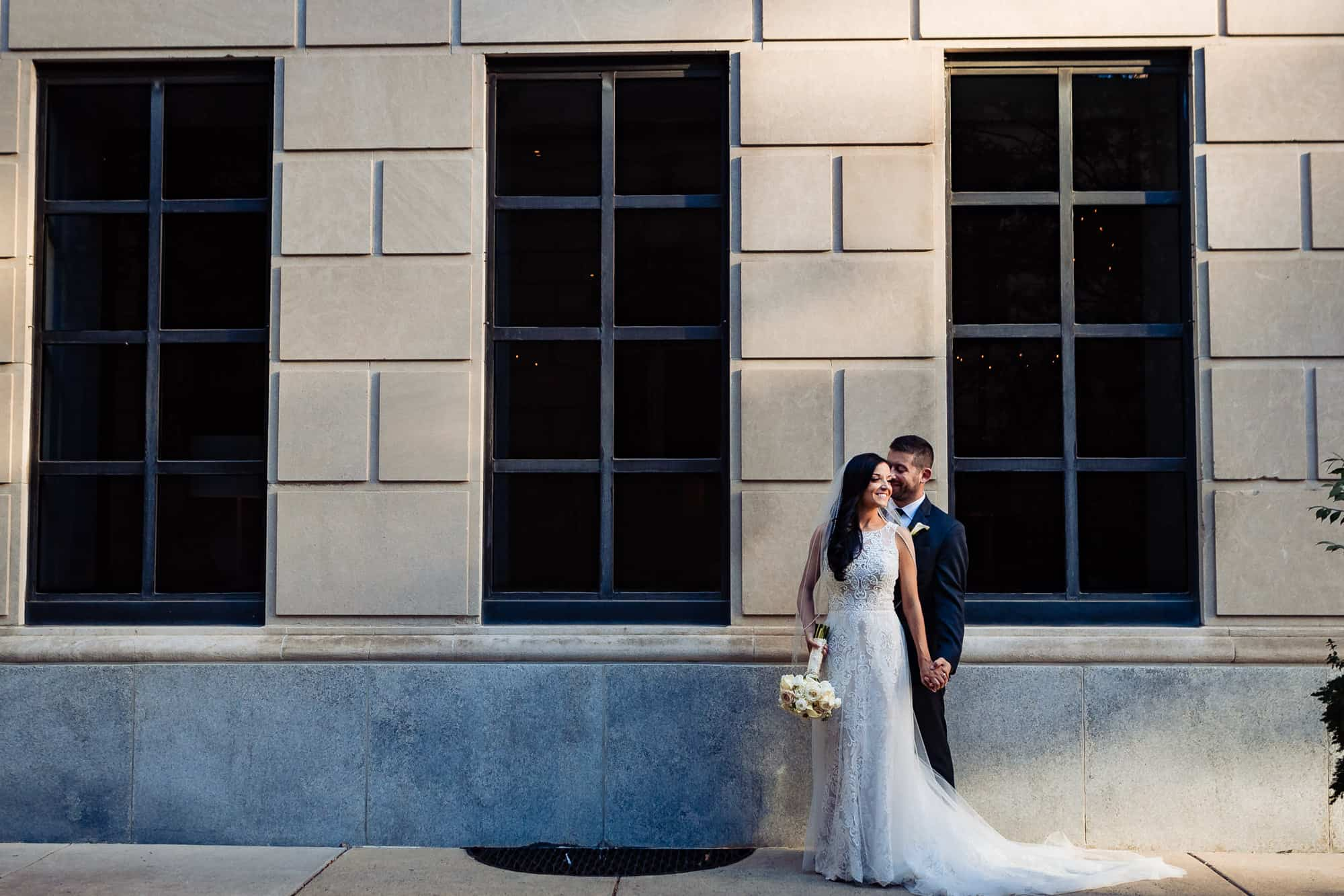 bride and groom posing together before their Arts Ballroom Philadelphia wedding