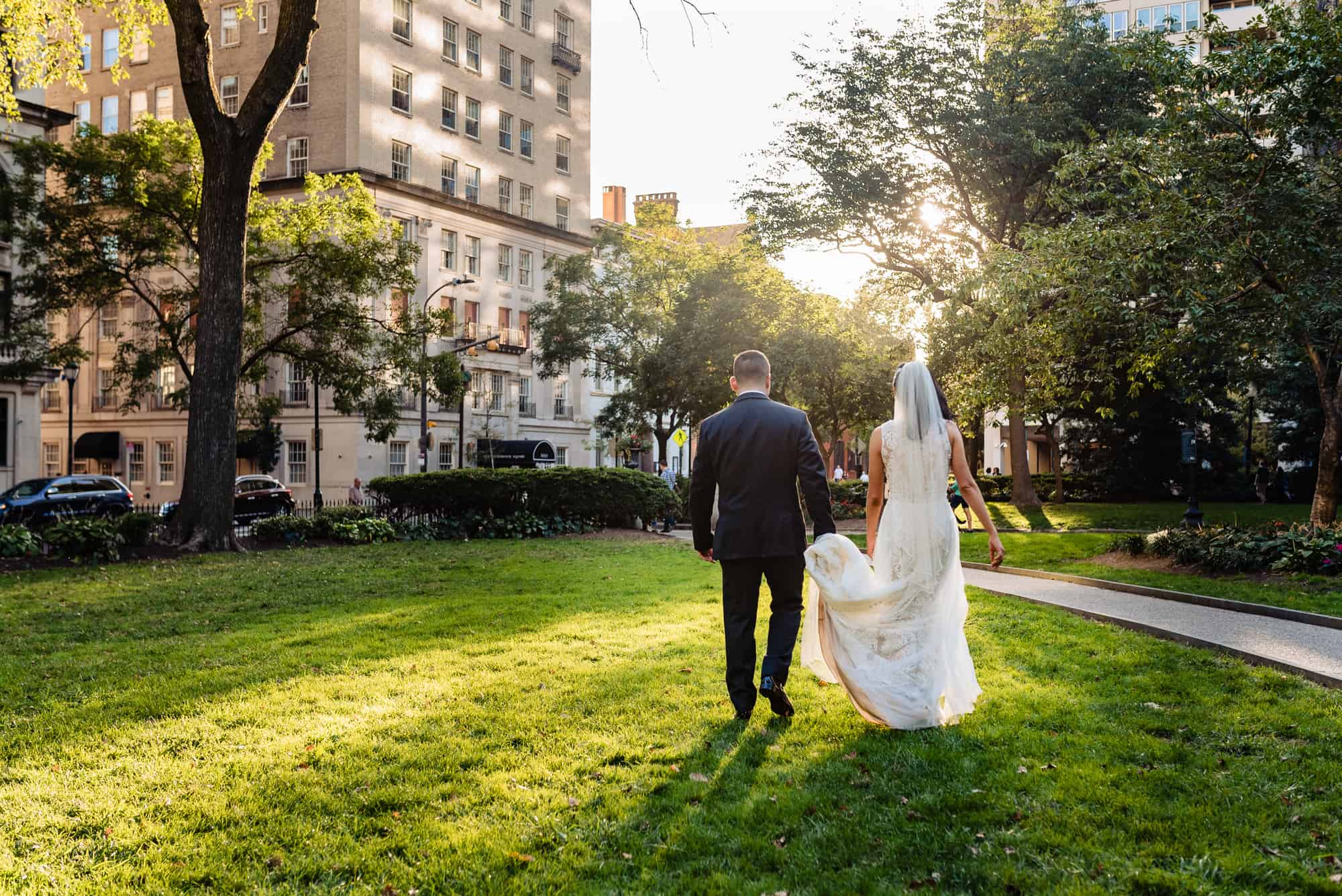 bride and groom walking hand in hand before their Arts Ballroom Philadelphia Wedding