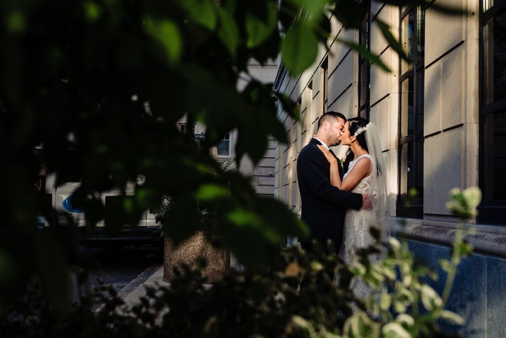 bride and groom kissing before their Arts Ballroom Philadelphia wedding