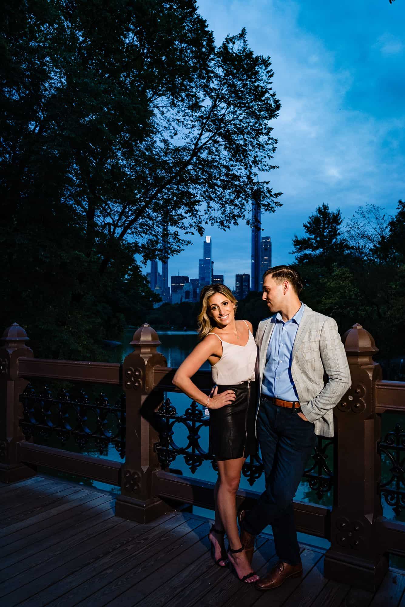 man and women posing in an image from their central park eshoot