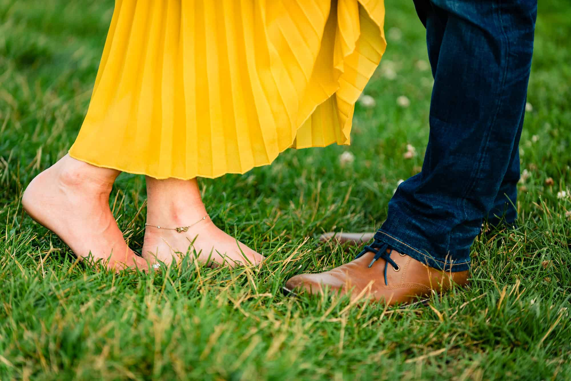 close up image of a womens bare feet and her fiances shoes shot during their Longwood Gardens eshoot