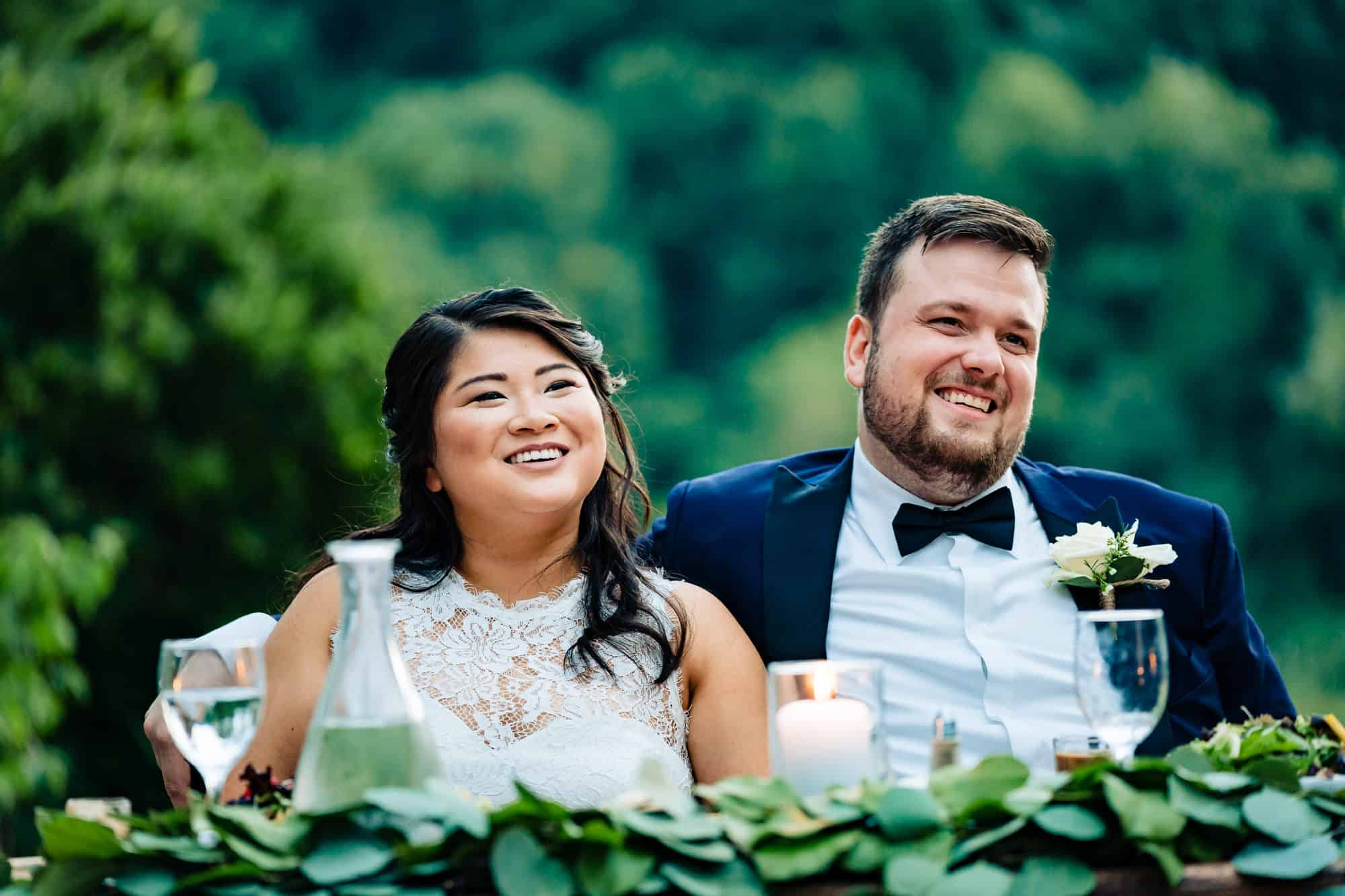 candid image of bride and groom laughing at the Welkinweir Estate