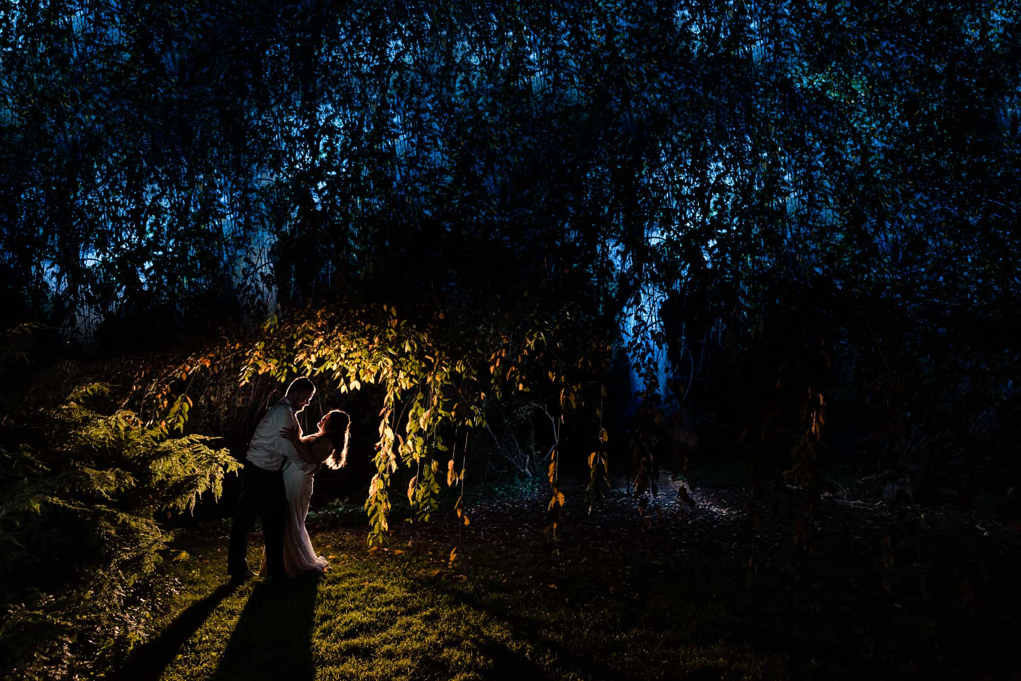 dramatic night image of couple embracing at Welkinweir estate